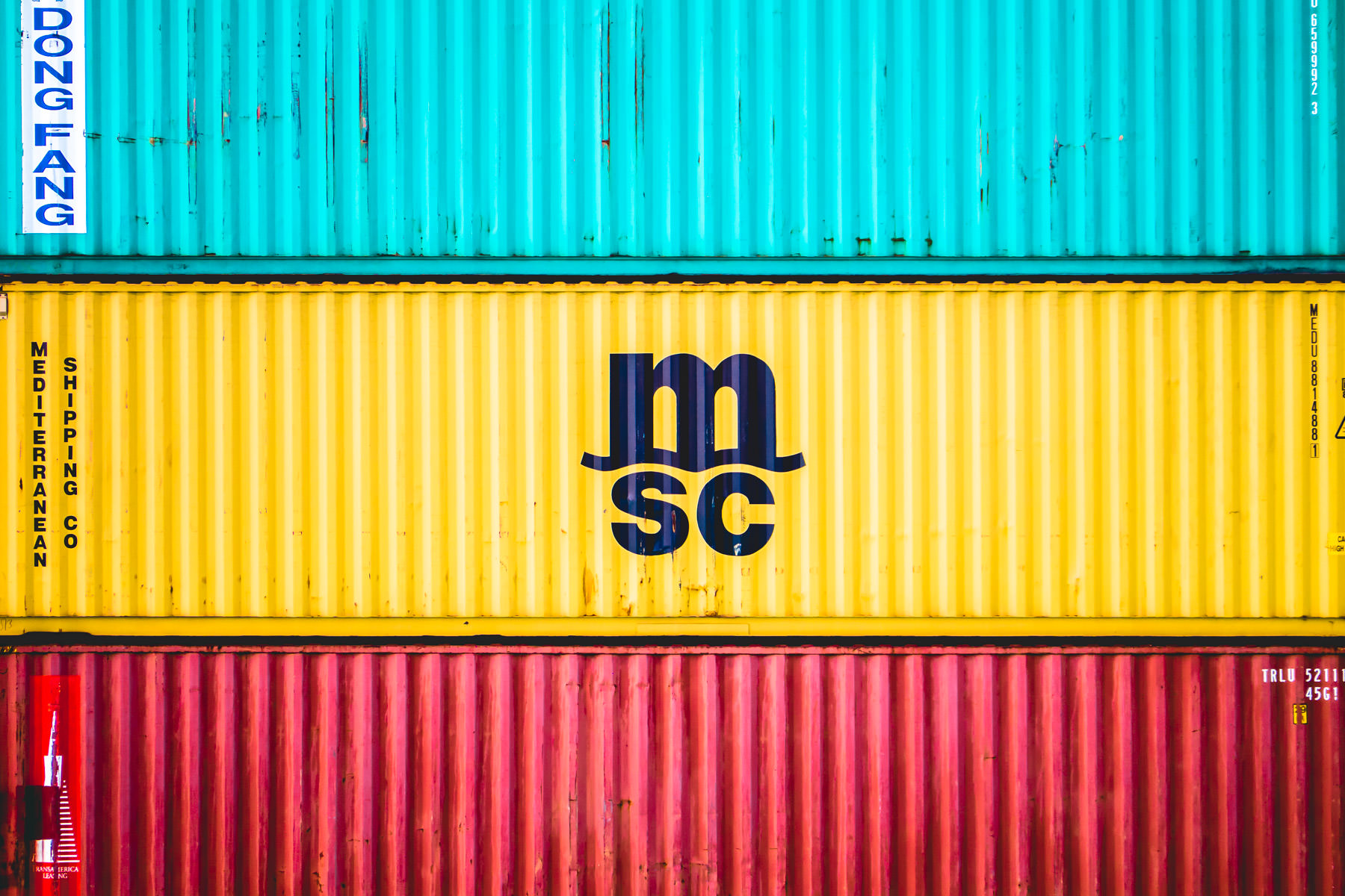 Multi-colored shipping containers of the Mediterranean Shipping Company sit stacked in a container yard in Freeport, Bahamas.