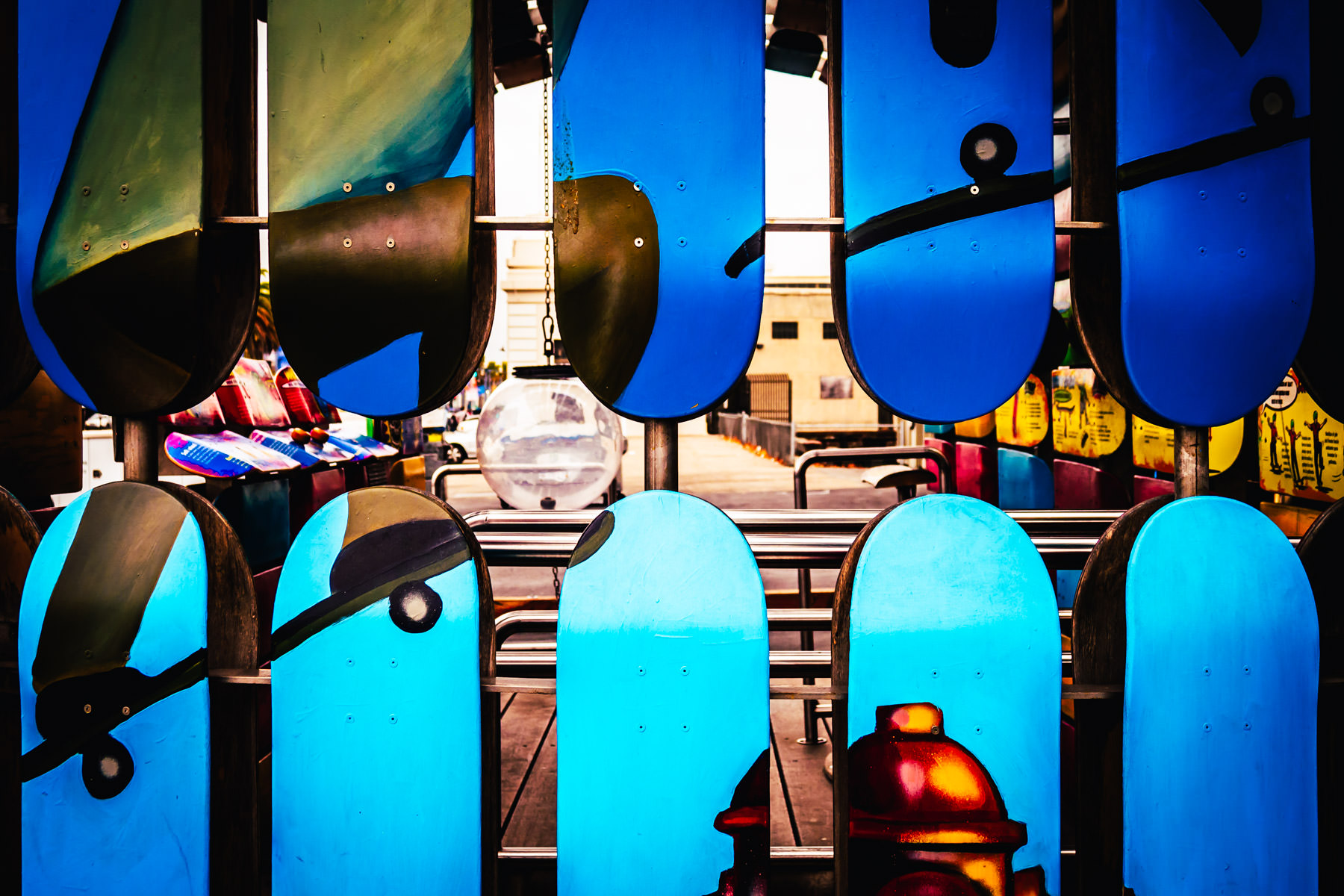 """A few of the roughly 400 skateboards that cover San Francisco's Exploratorium's """"skateboard science trailer parklet"""" resemble the colorful teeth of an imagined monster."""