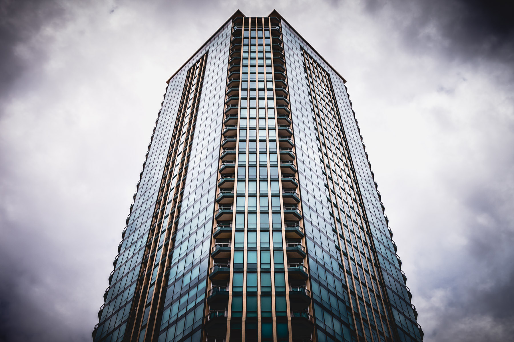 Fort Worth's tallest residential building—The Tower—rises into the cloudy, rain-laden North Texas sky.