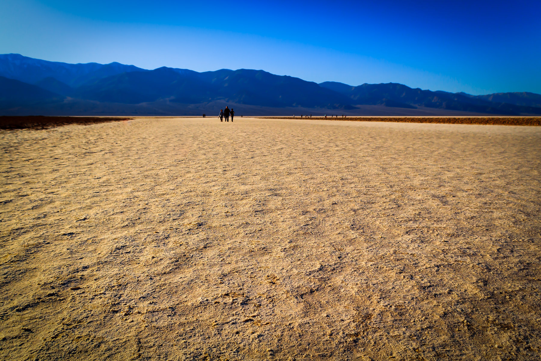Visitors walk the salt flats at Badwater Basin—the lowest point in North America—in California's Death Valley National Park.