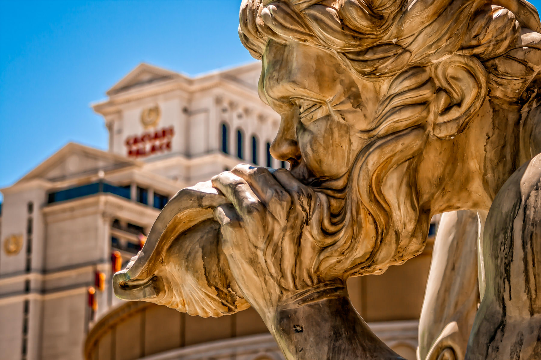 A triton at Caesars Palace's reproduction of Rome's Trevi Fountain blows his shell to announce the arrival of Oceanus' chariot.