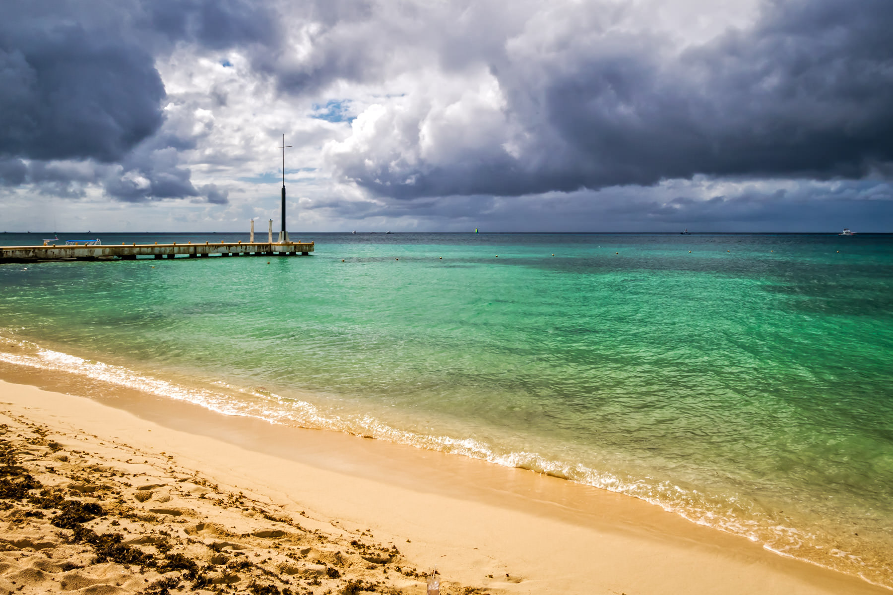 Storm clouds roll towards the beach at Cozumel, Mexico's Nachi Cocom Beach Club.