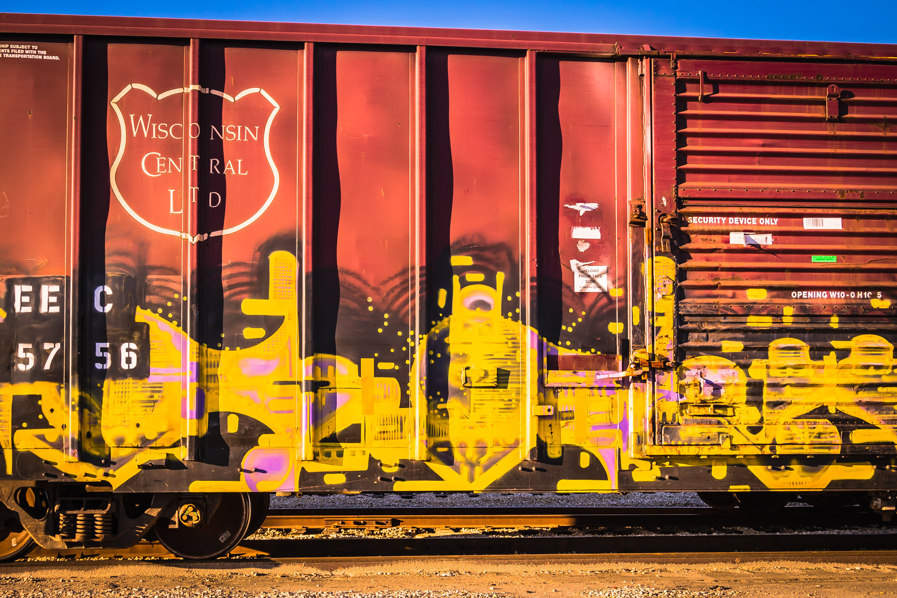 A graffiti-festooned boxcar of the Wisconsin Central Ltd. railroad, spotted in a Galveston, Texas, rail yard.