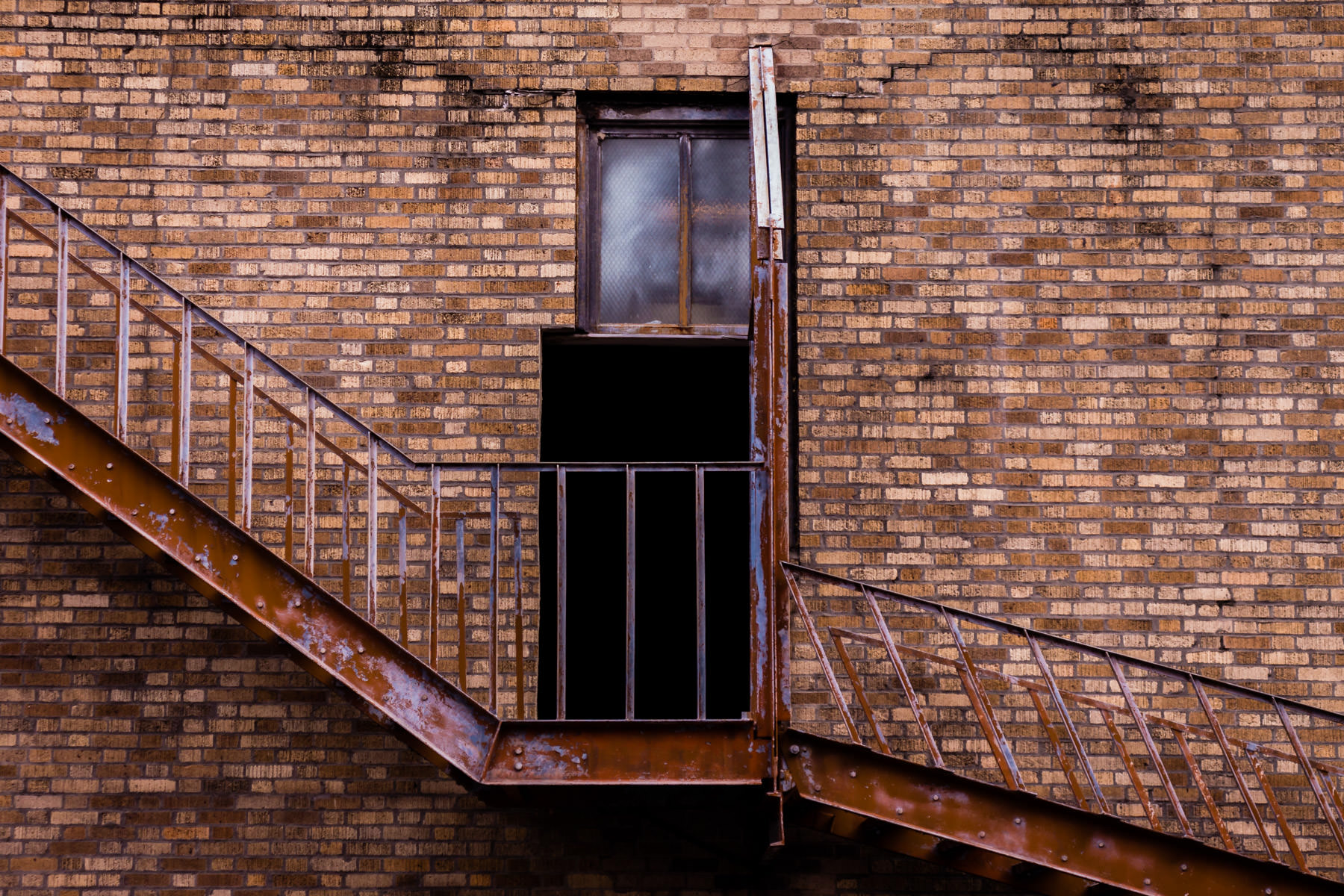 A doorway leads to a rusting fire escape at Downtown Houston's Great Southwest Building.