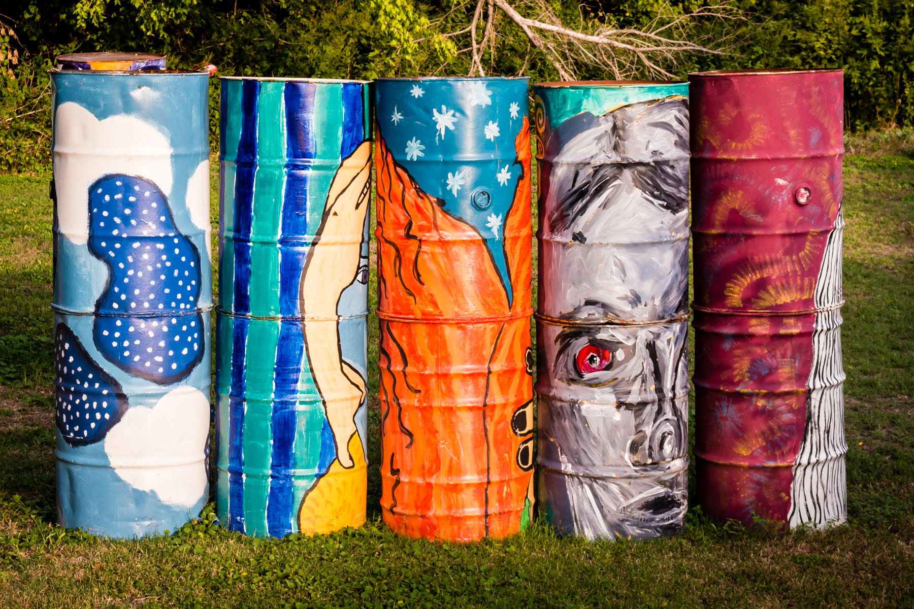 55-gallon drums welded together and painted to make artwork in a Waxahachie, Texas, park.