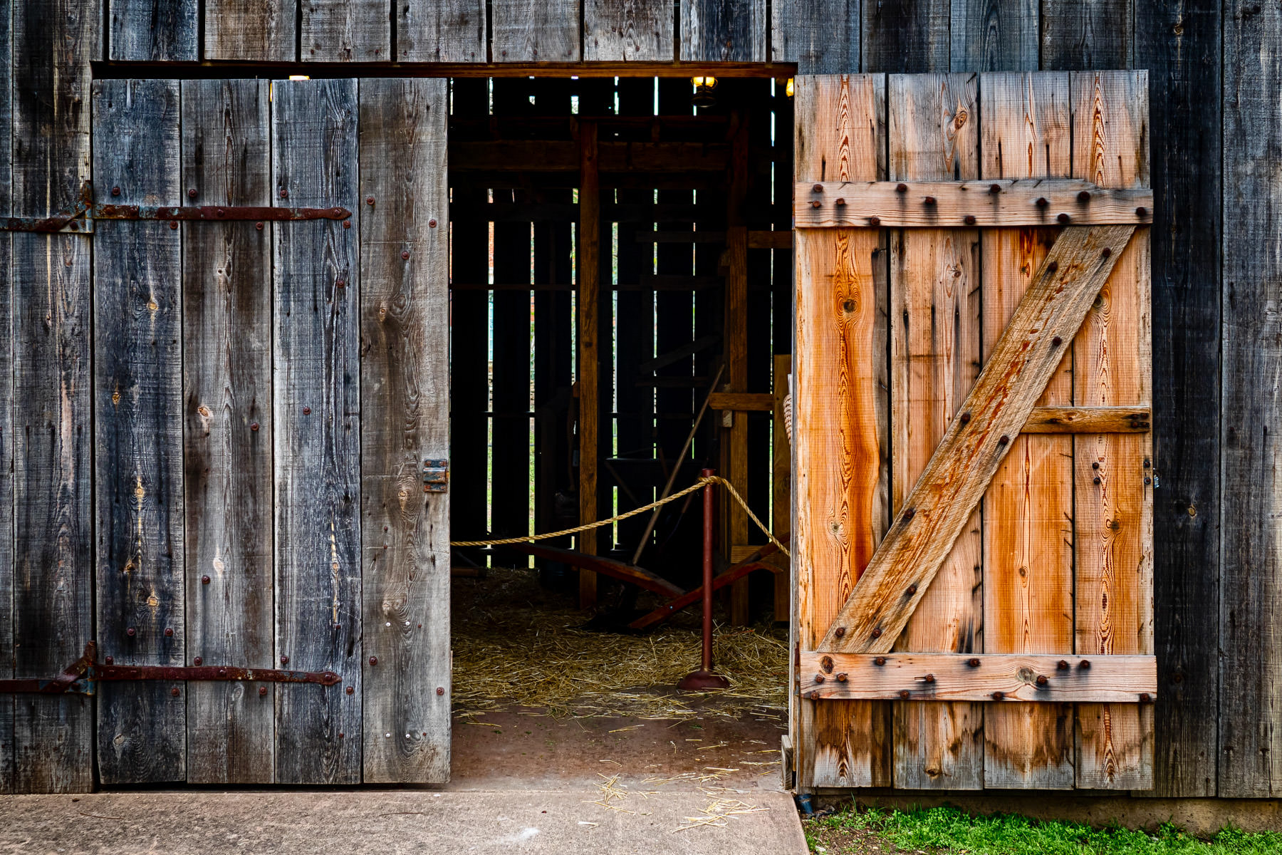 An open door on a barn at the Governor Bill and Vara Daniel Historic Village at Waco, Texas' Mayborn Museum.