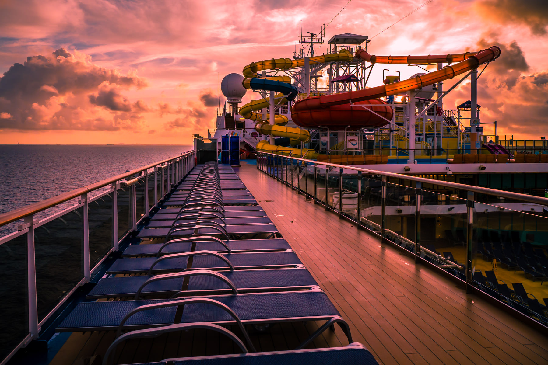 The Carnival Magic's onboard waterpark is backlit by the rising sun just off the coast of Freeport, Bahamas.
