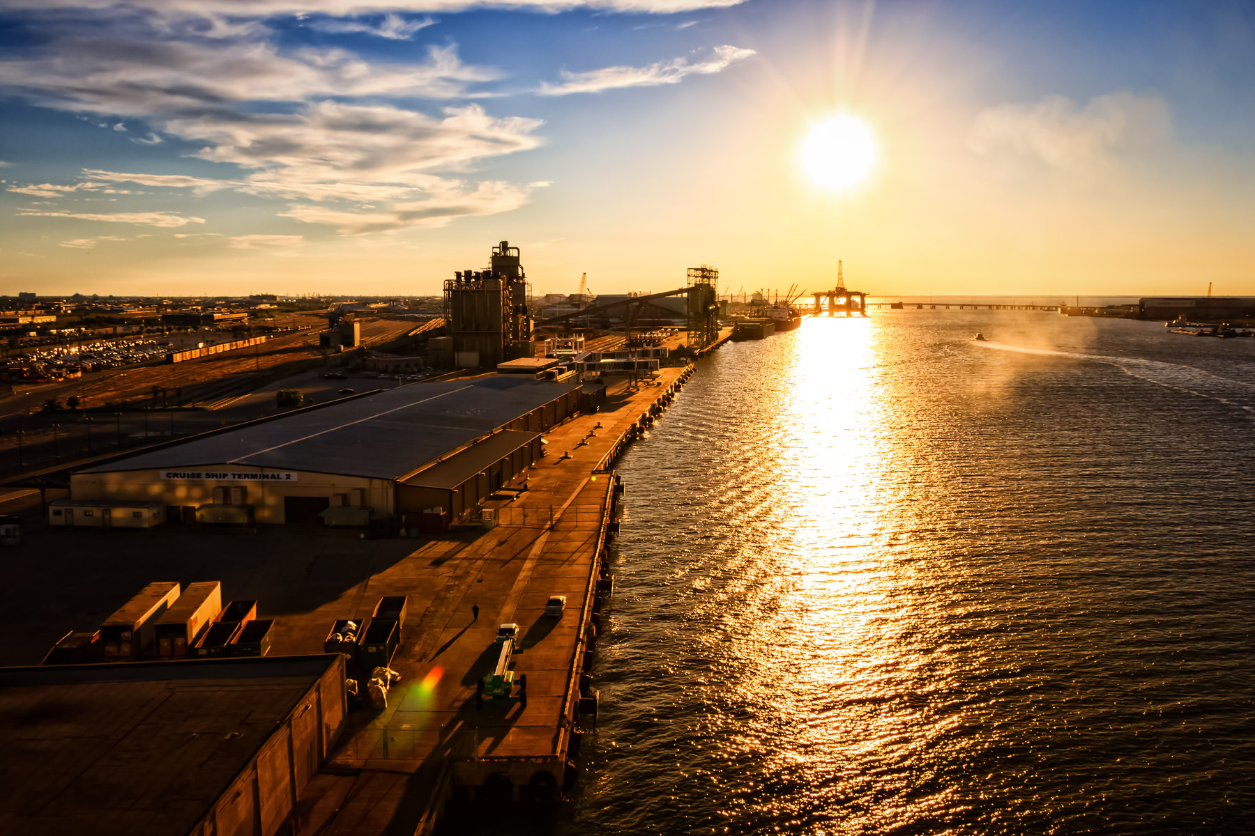 The Port of Galveston is illuminated by the sun setting along the Texas Coast.