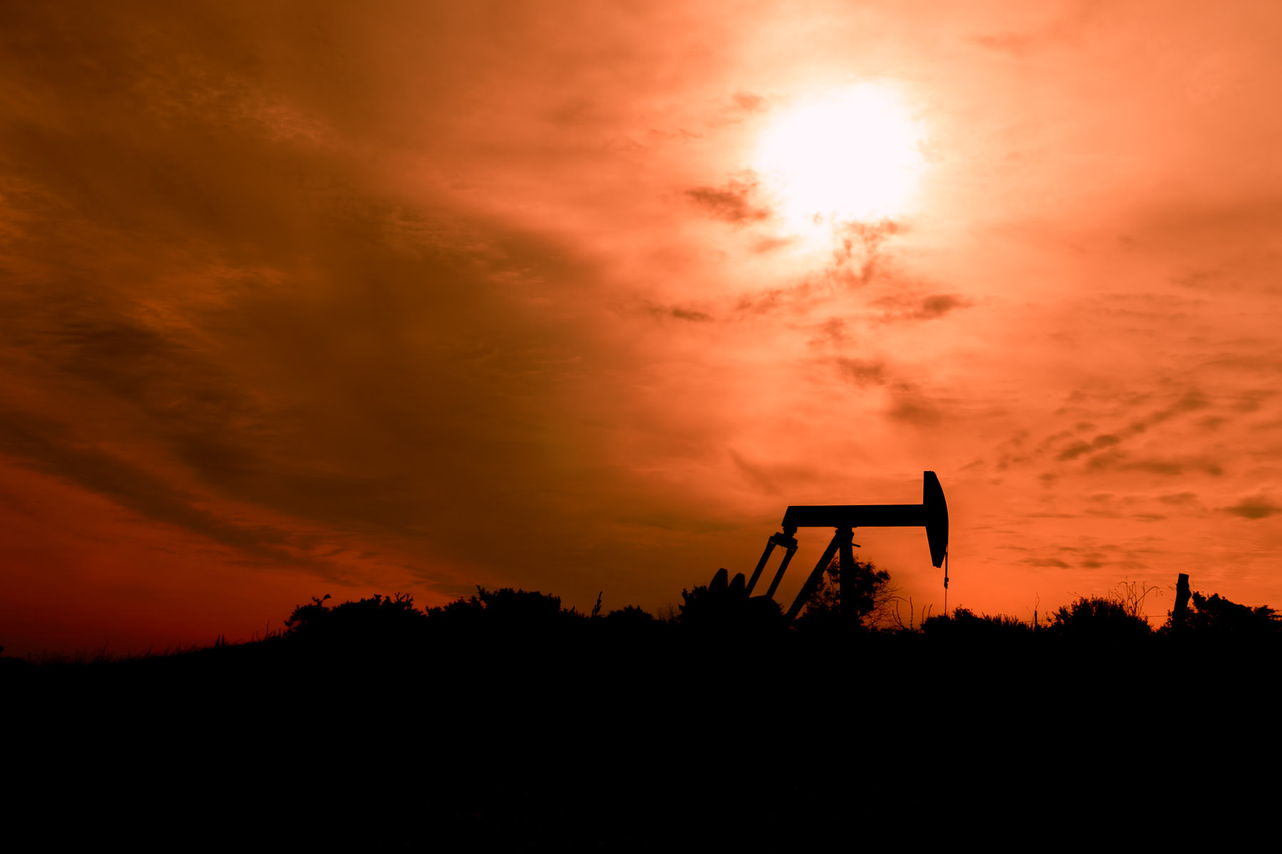 A pumpjack is silhouetted by the morning sun near Sherman, Texas.