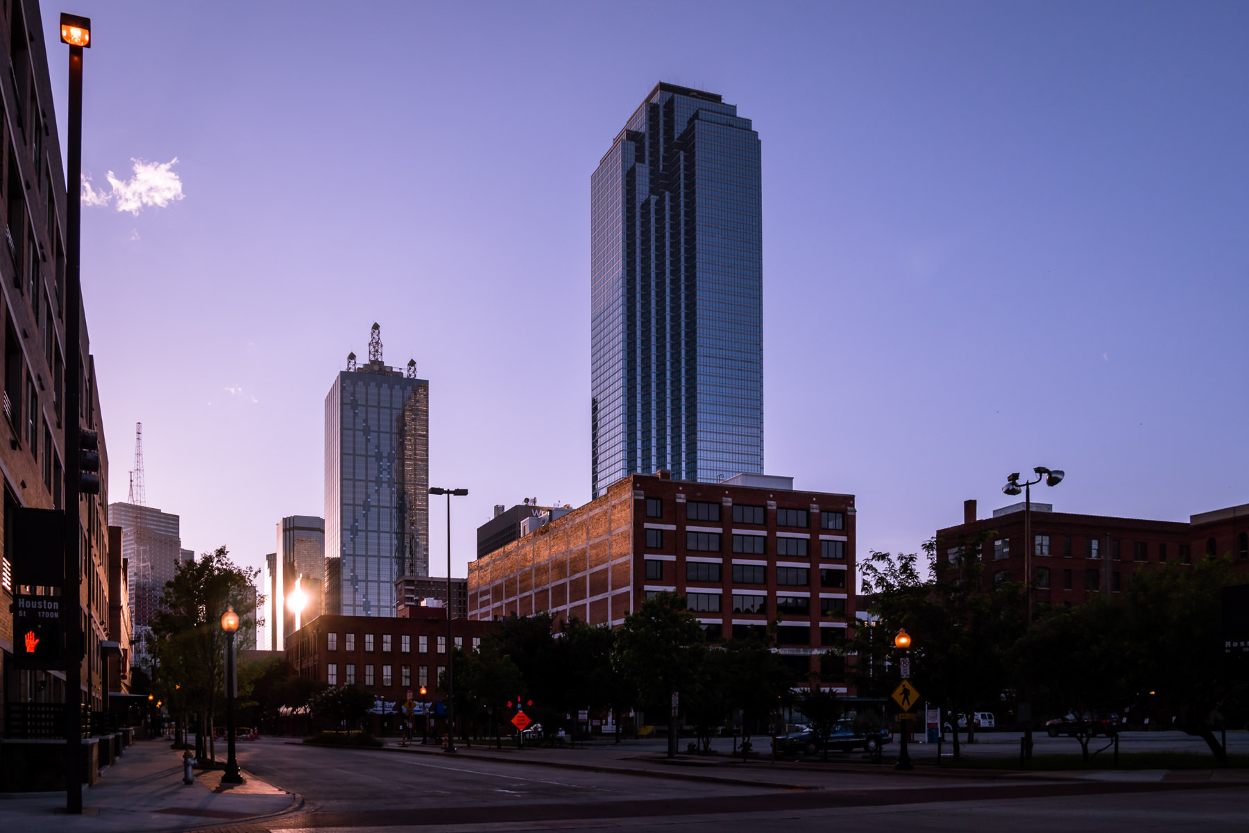 The morning sun glints off Downtown Dallas' LTV Tower as its first light illuminates the city.