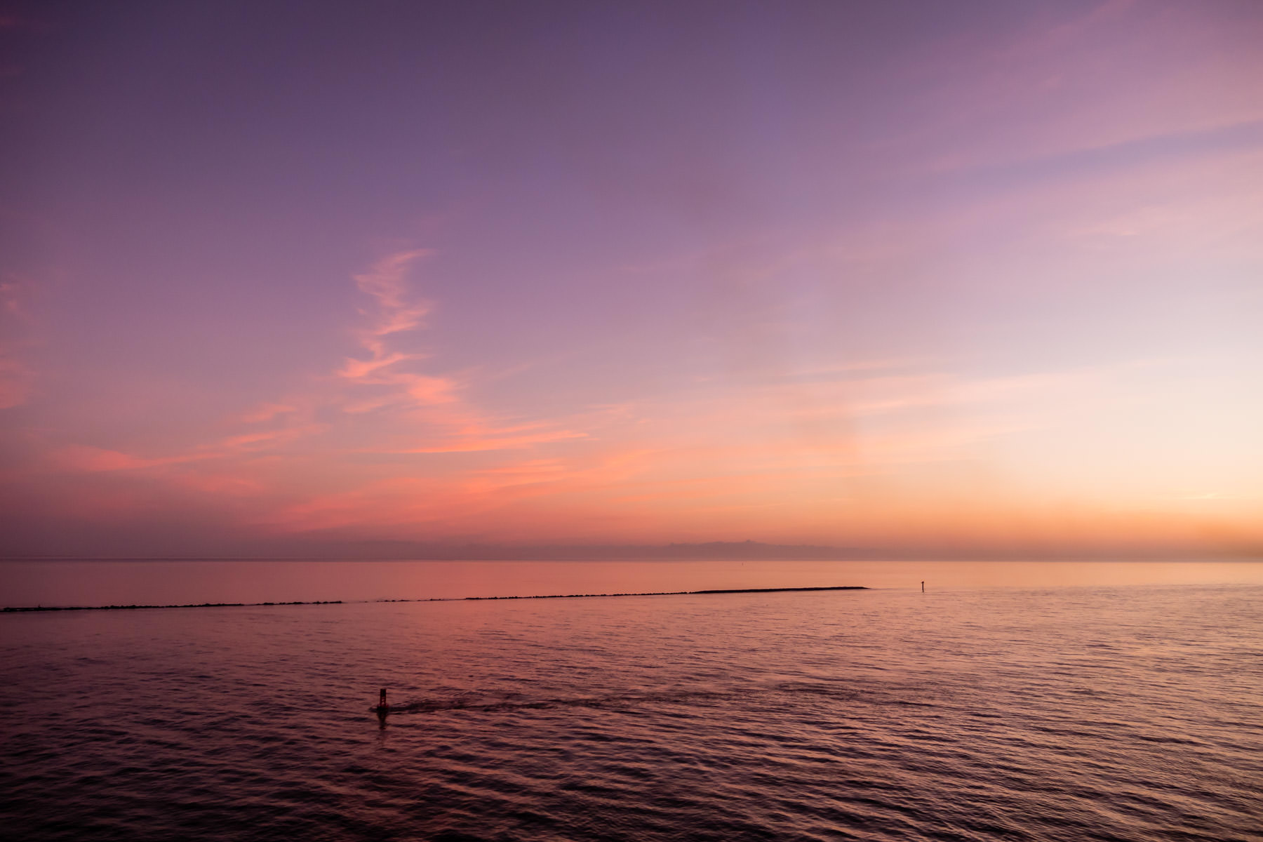 Dawn opens on the north jetty at the entrance to Galveston Bay and the Houston Ship Channel, Texas.