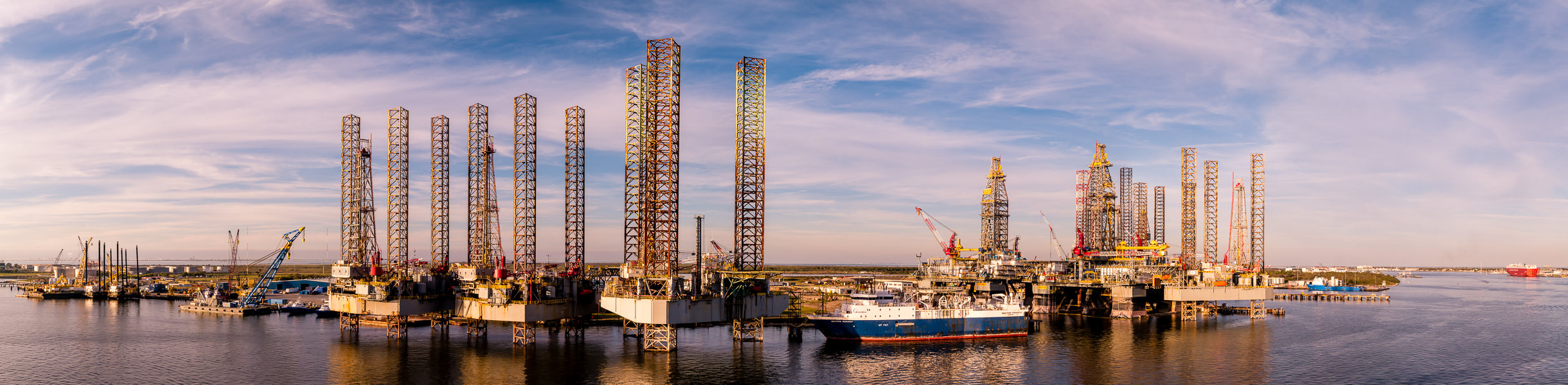 Long-legged oil platforms laid up for storage and repair at Pelican Island, Galveston, Texas.