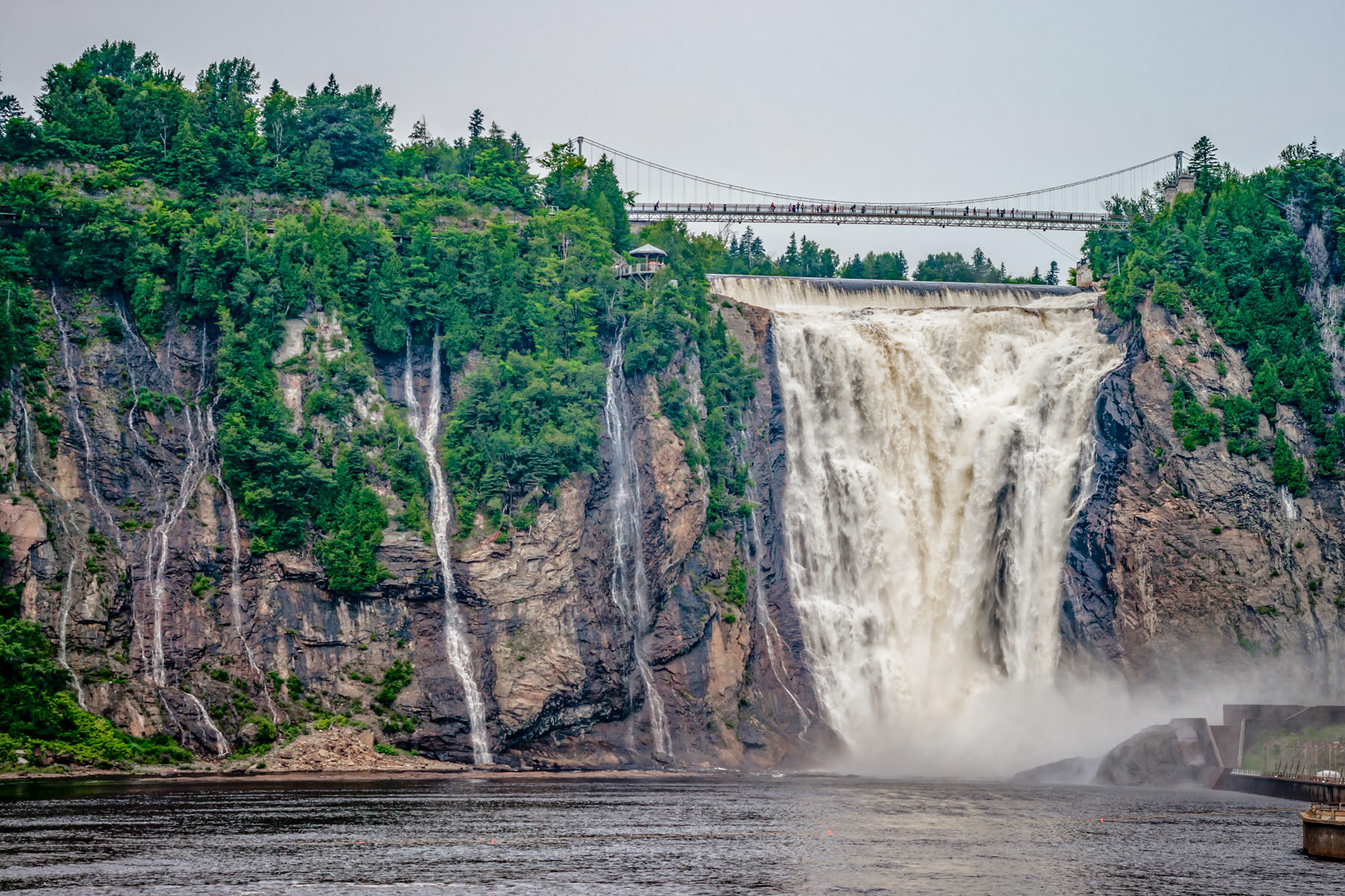 Muddy water from the Montmorency River tumbles over Montmorency Falls just outside of Québec City, Canada.