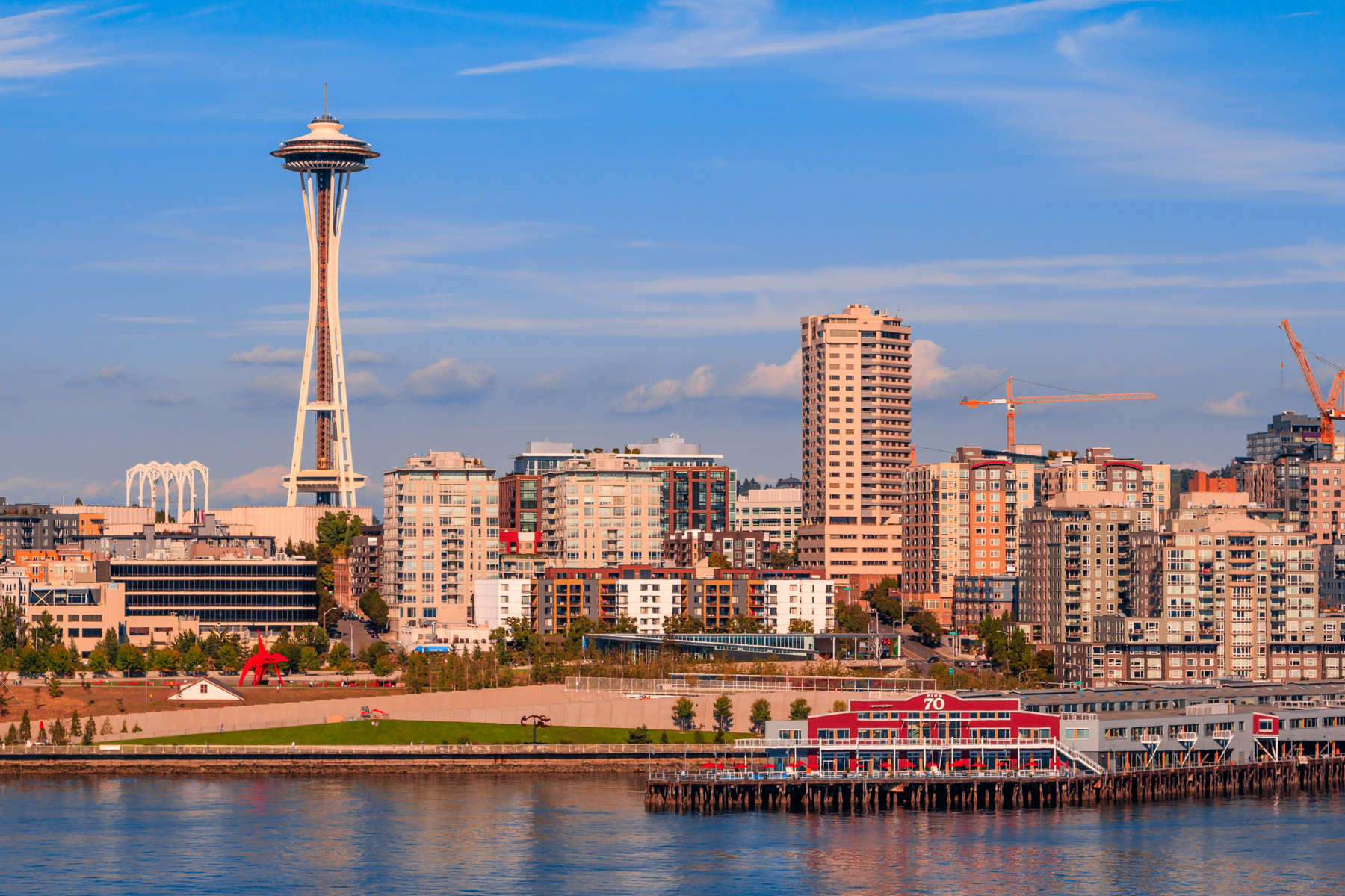 The Seattle Space Needle towers over the Seattle Center and the surrounding Lower Queen Anne neighborhood.
