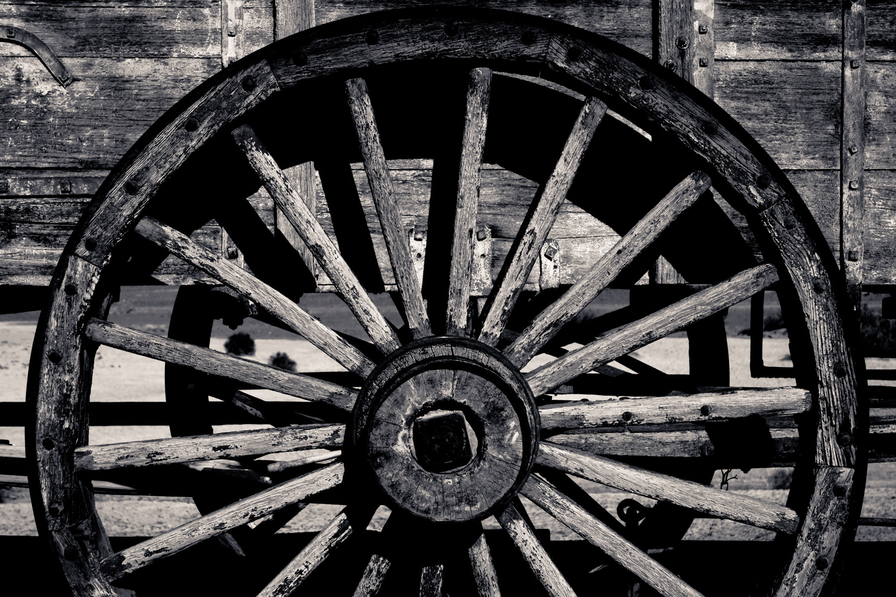 Detail of a wheel on an old borax-hauling wagon train on display in California's Death Valley National Park.