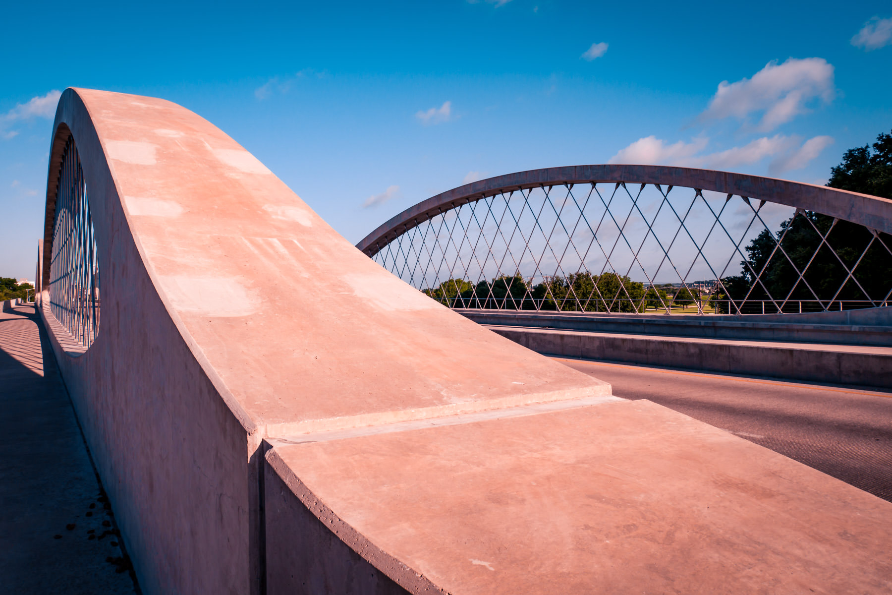 The arches of Fort Worth, Texas' iconic West Seventh Street Bridge rise and dip inthe North Texas sky.