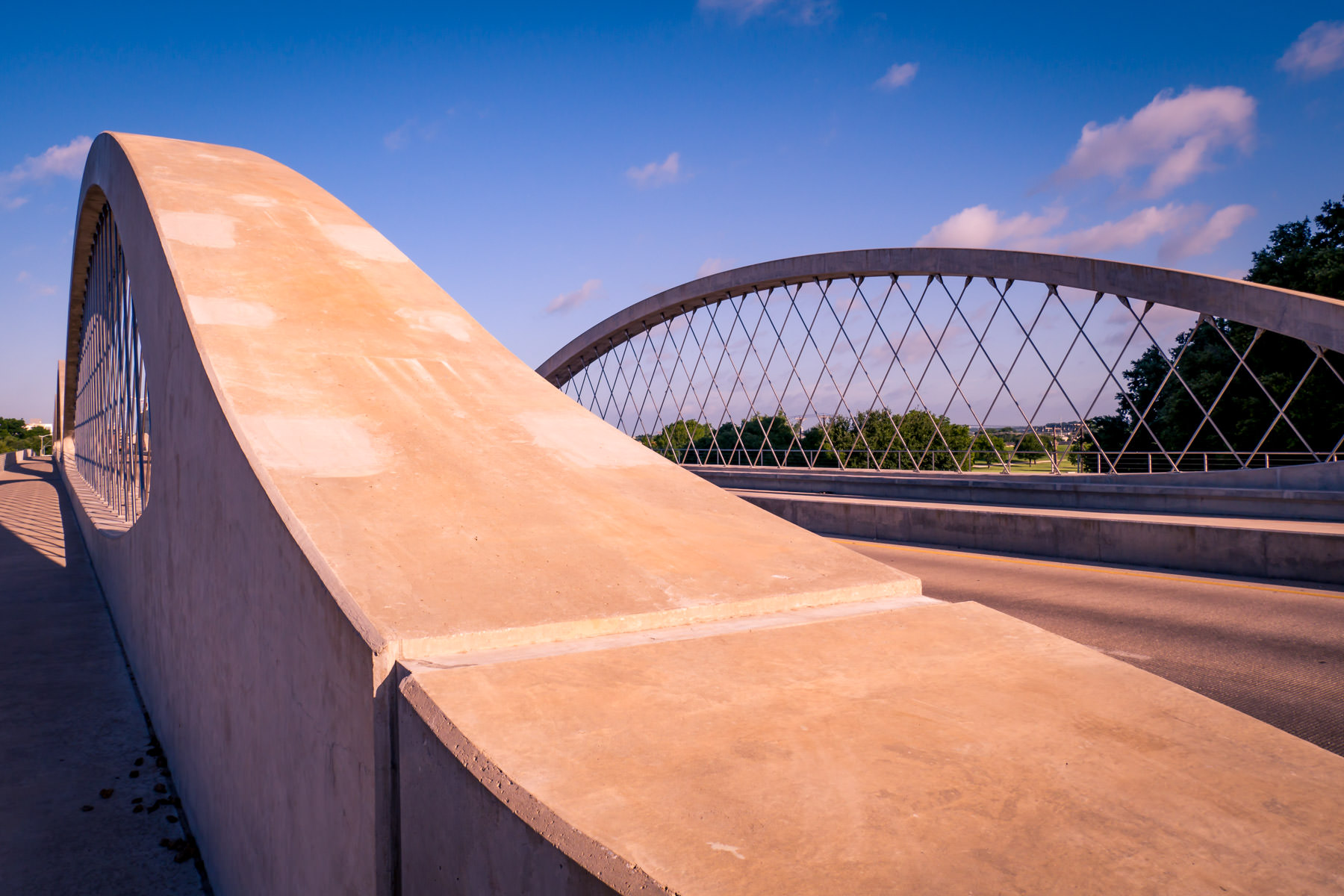 The arches of Fort Worth, Texas' iconic West Seventh Street Bridge rise and dip in the North Texas sky.