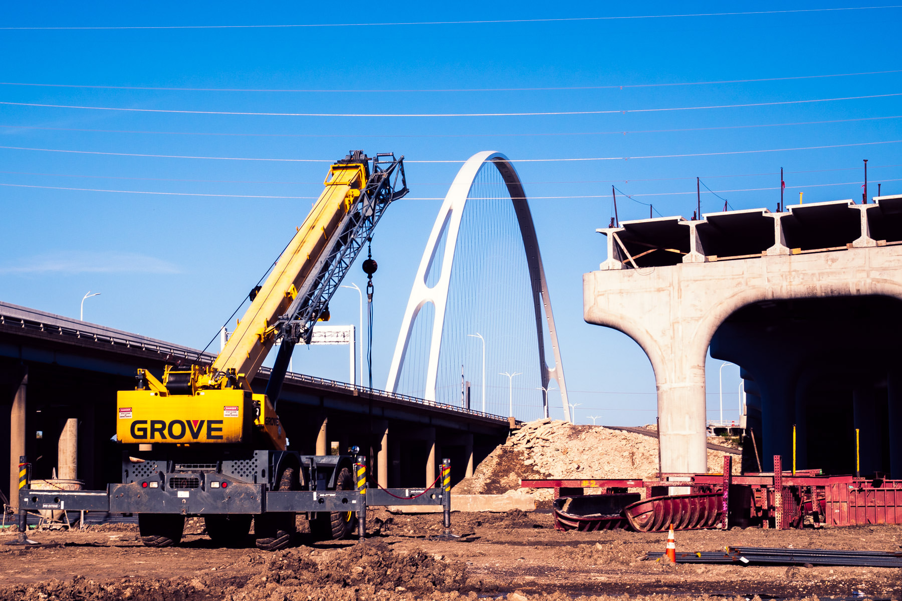 The first arch of Dallas' Margaret McDermott Bridge rises over the structure's construction site on the banks of the Trinity River.