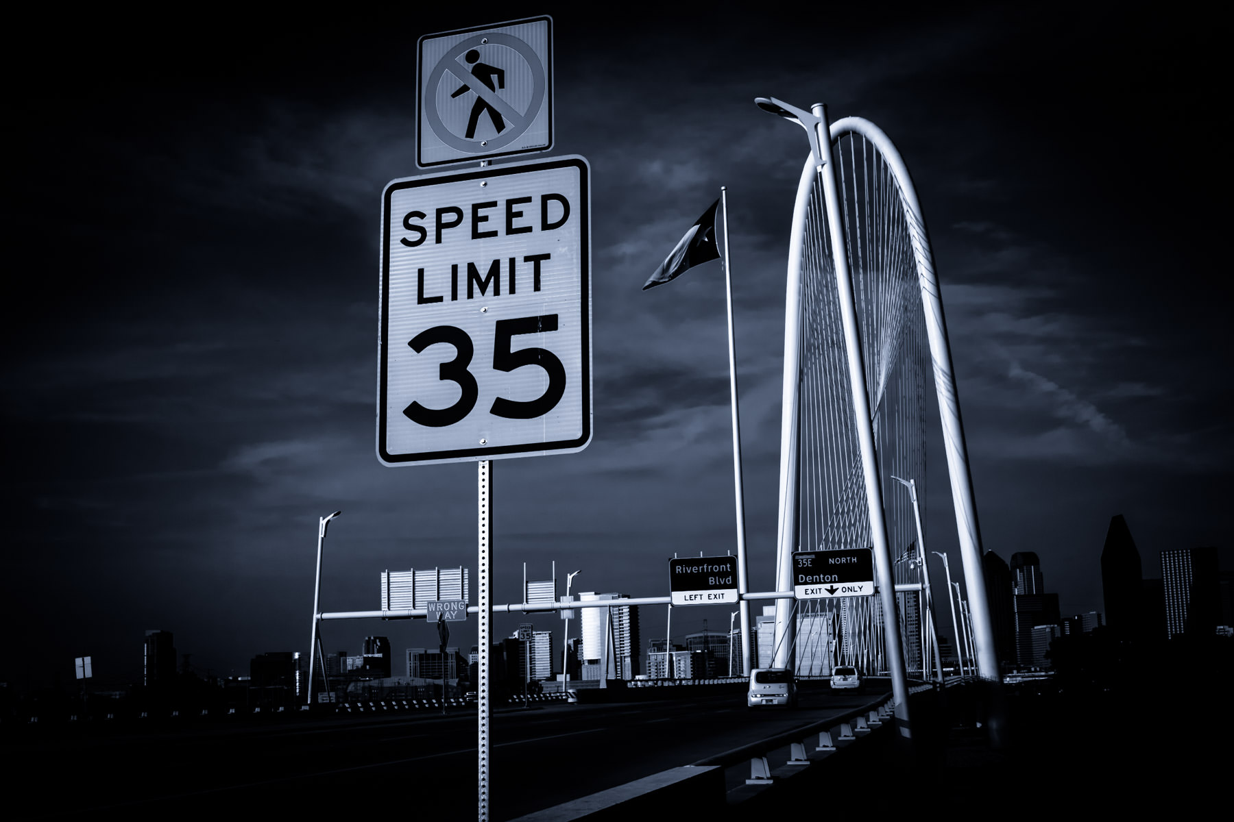 A speed limit sign on the eastbound approach to Dallas' Santiago Calatrava-designed Margaret Hunt Hill Bridge.