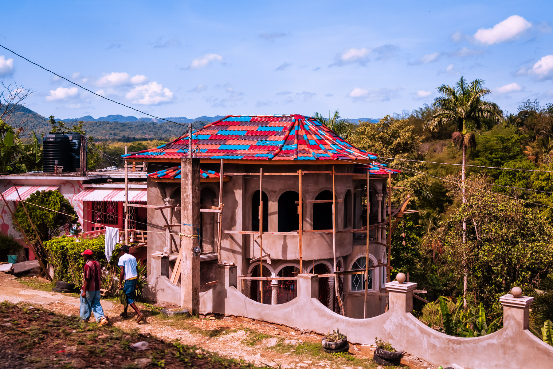 A house under construction amongst the forest and hills of Cambridge, Jamaica.