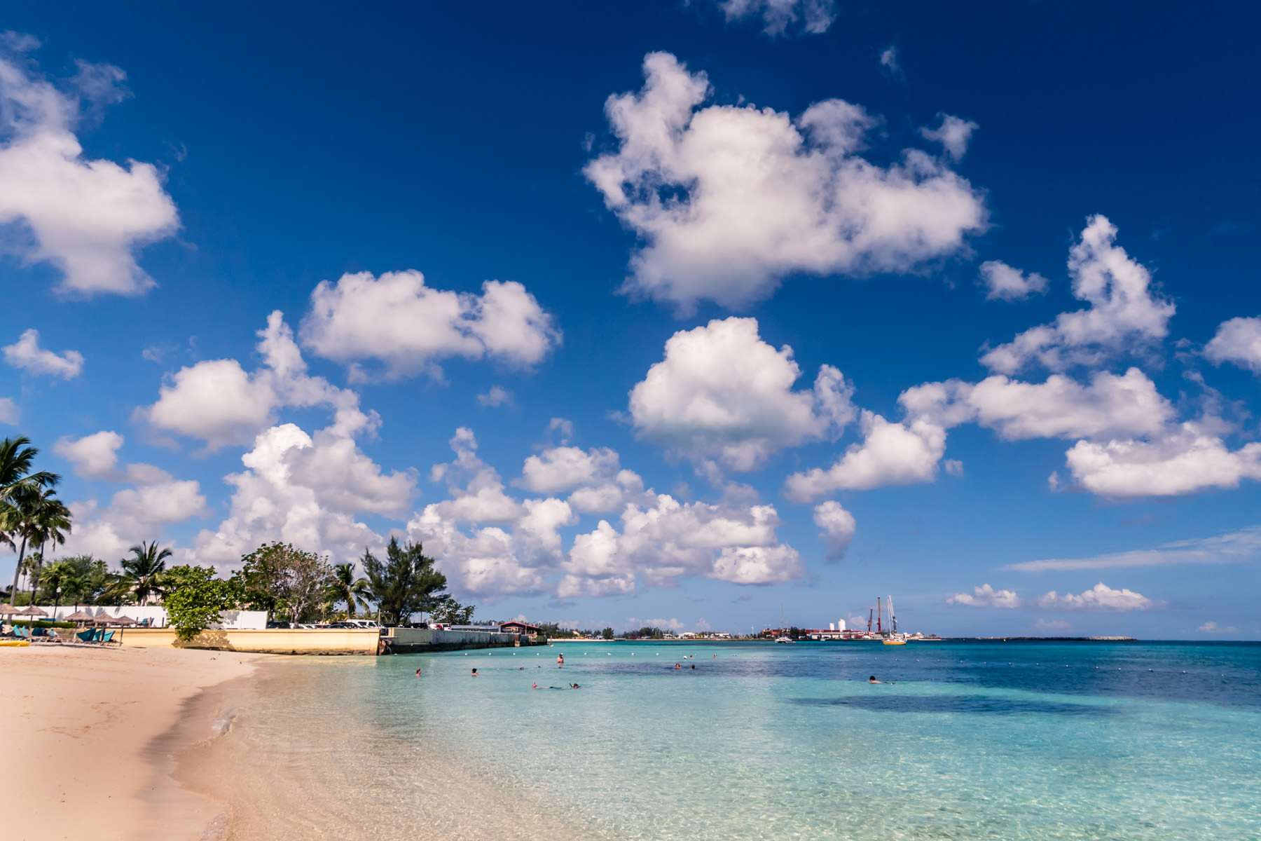 Clouds float over the harbor at Nassau, Bahamas, as seen from a beach at the British Colonial Hilton.