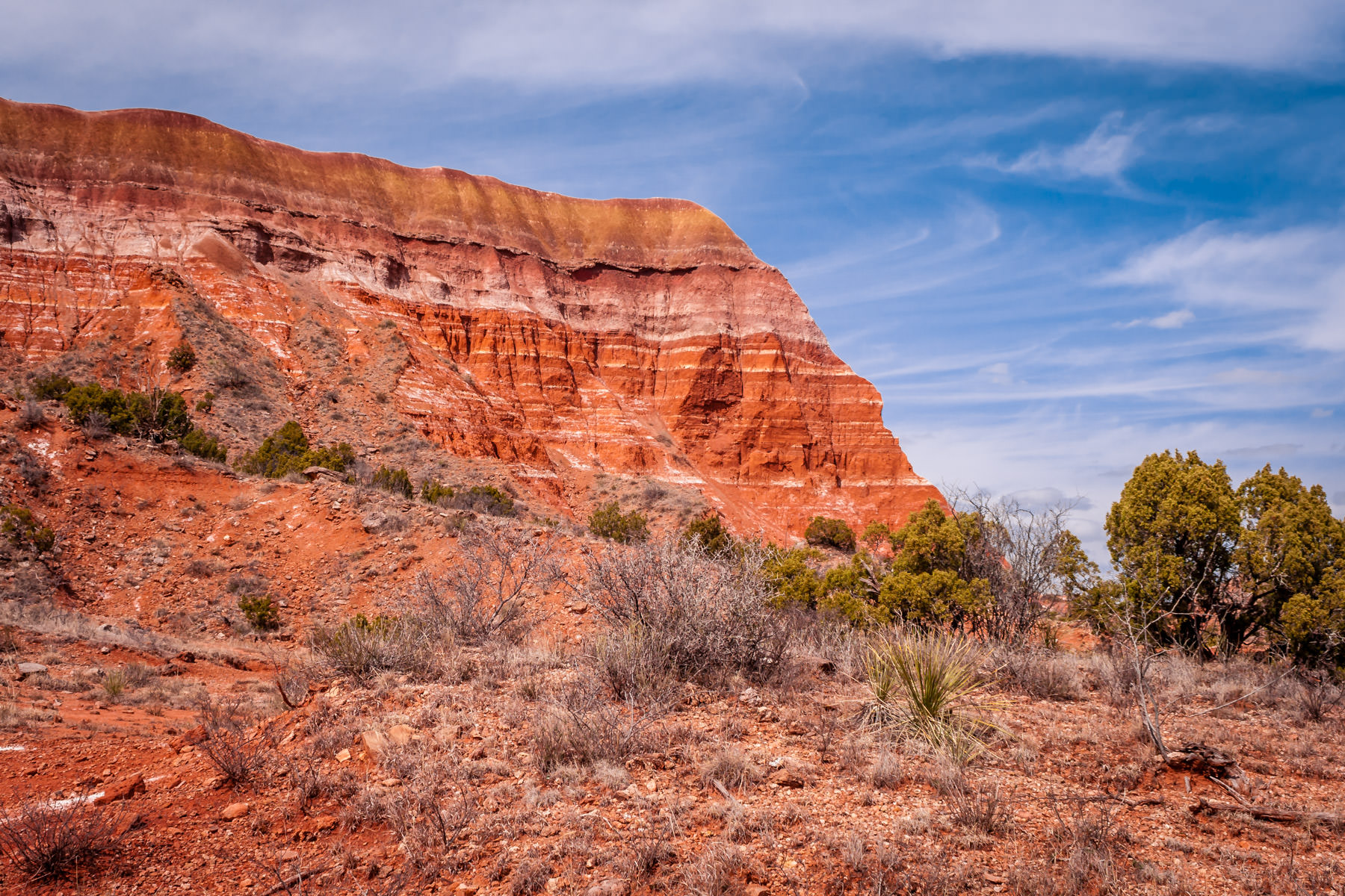 A rocky ridge—formed by millions of years of erosion along the Red River—makes up a canyon wall at Texas' Palo Duro Canyon.