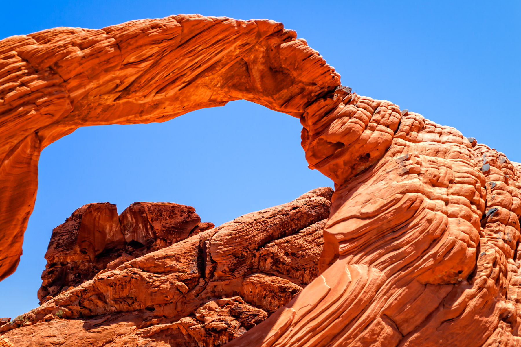 A rock arch reaches across the sky at Nevada's Valley of Fire State Park.