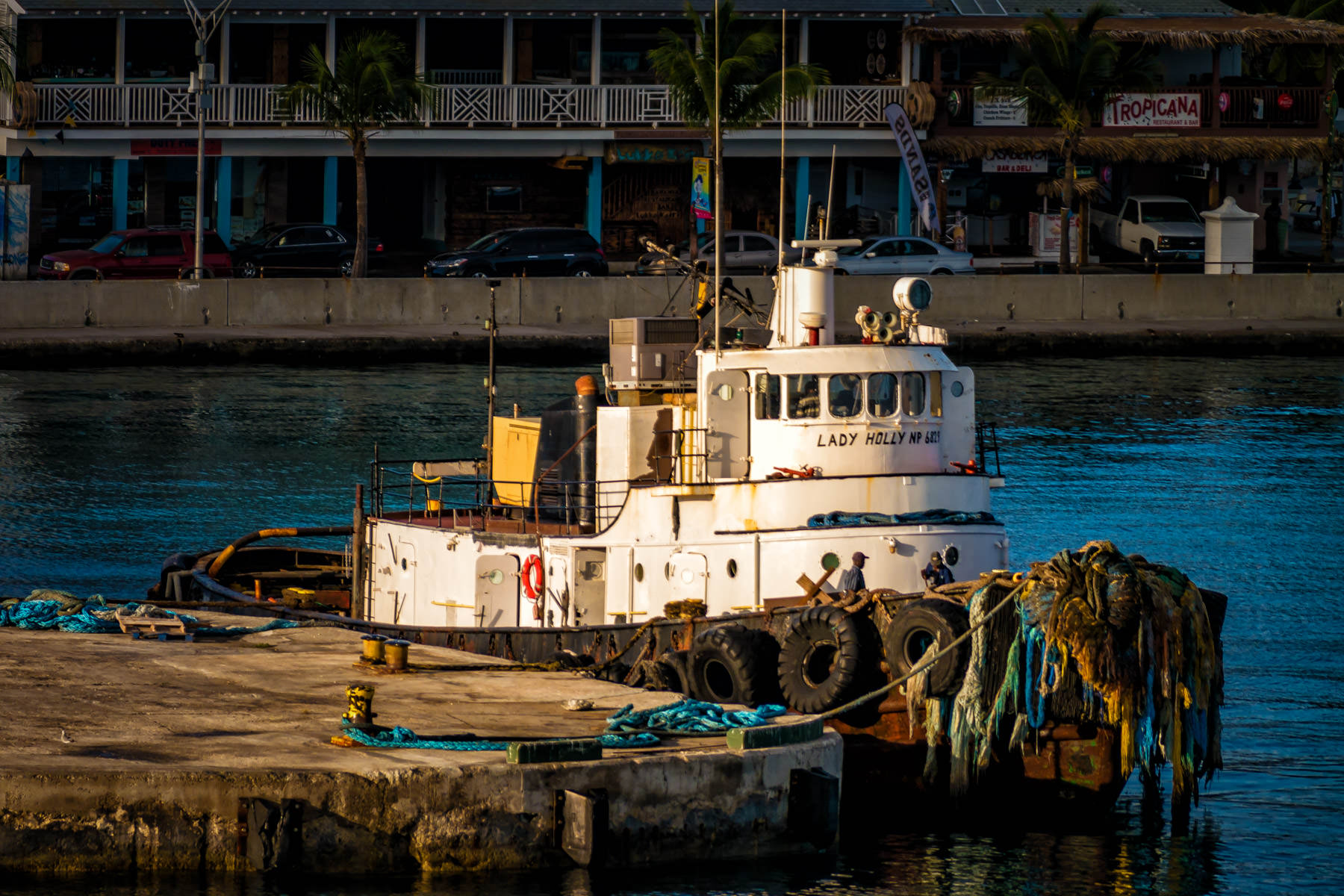 An old tugboat readies to go to work for the day in the harbour at Nassau, Bahamas.