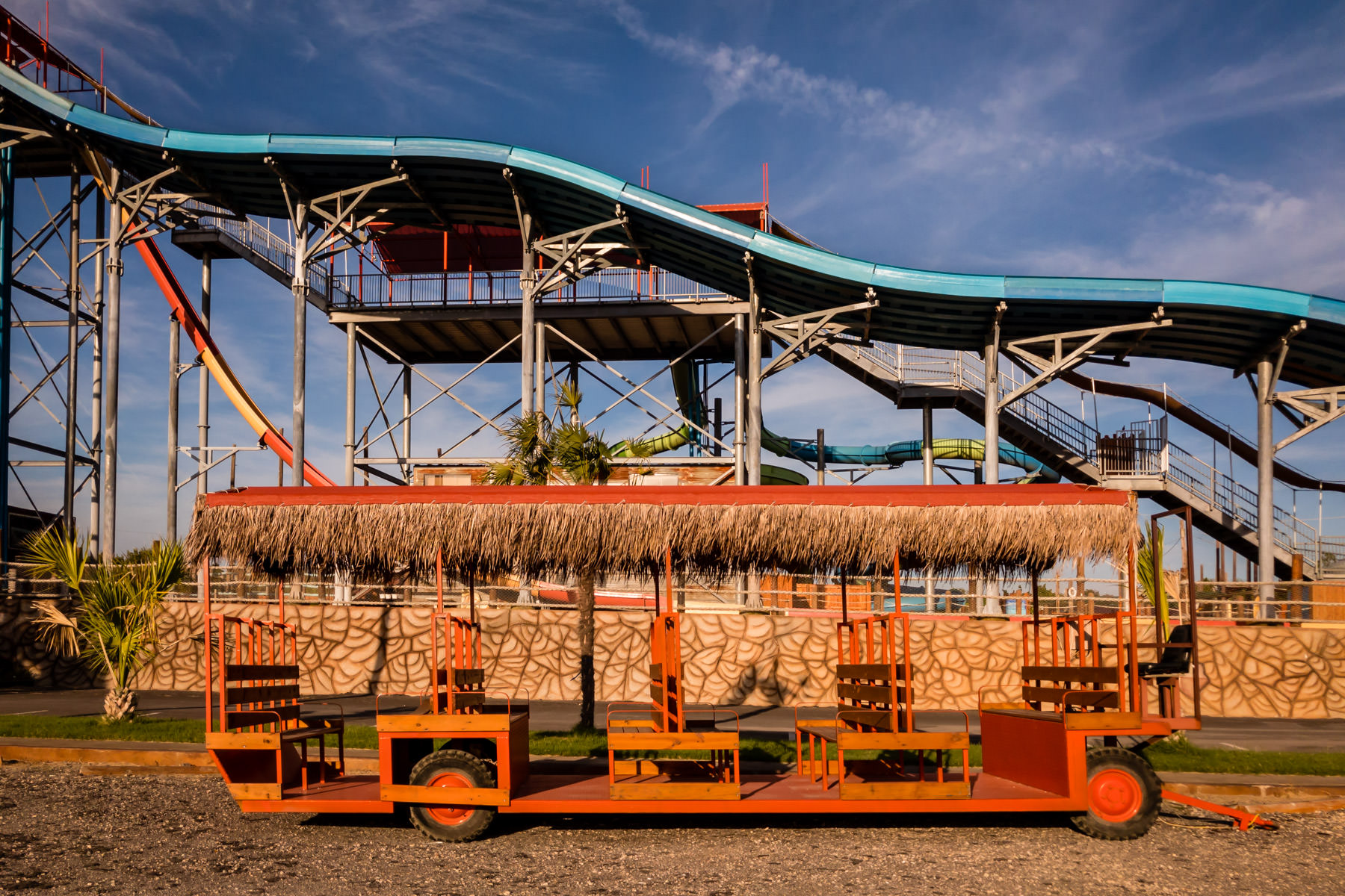 A tram's wagon sits outside the closed-for-the-year Pirates' Cove Waterpark in Burleson, Texas.
