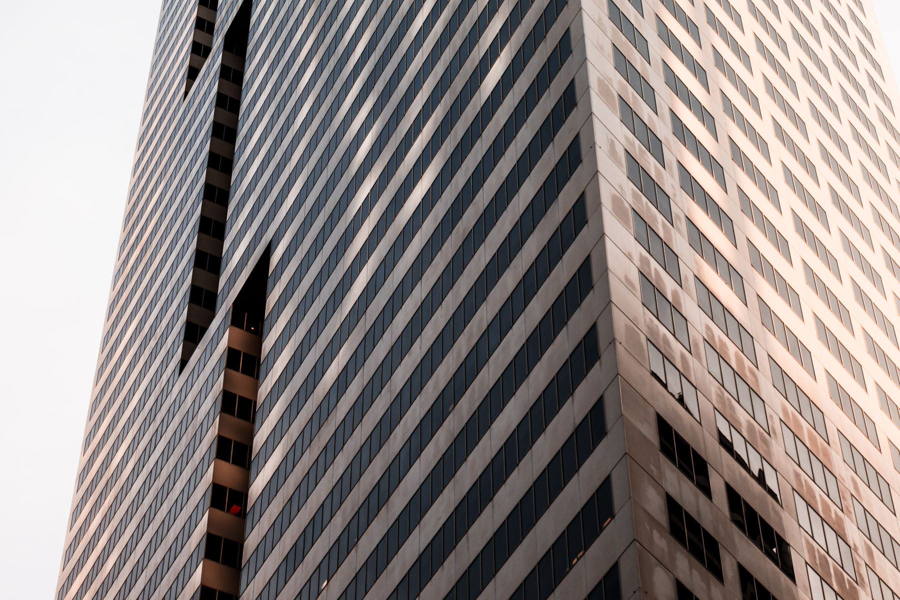 An abstract architectural study of Downtown Houston's First City Tower.