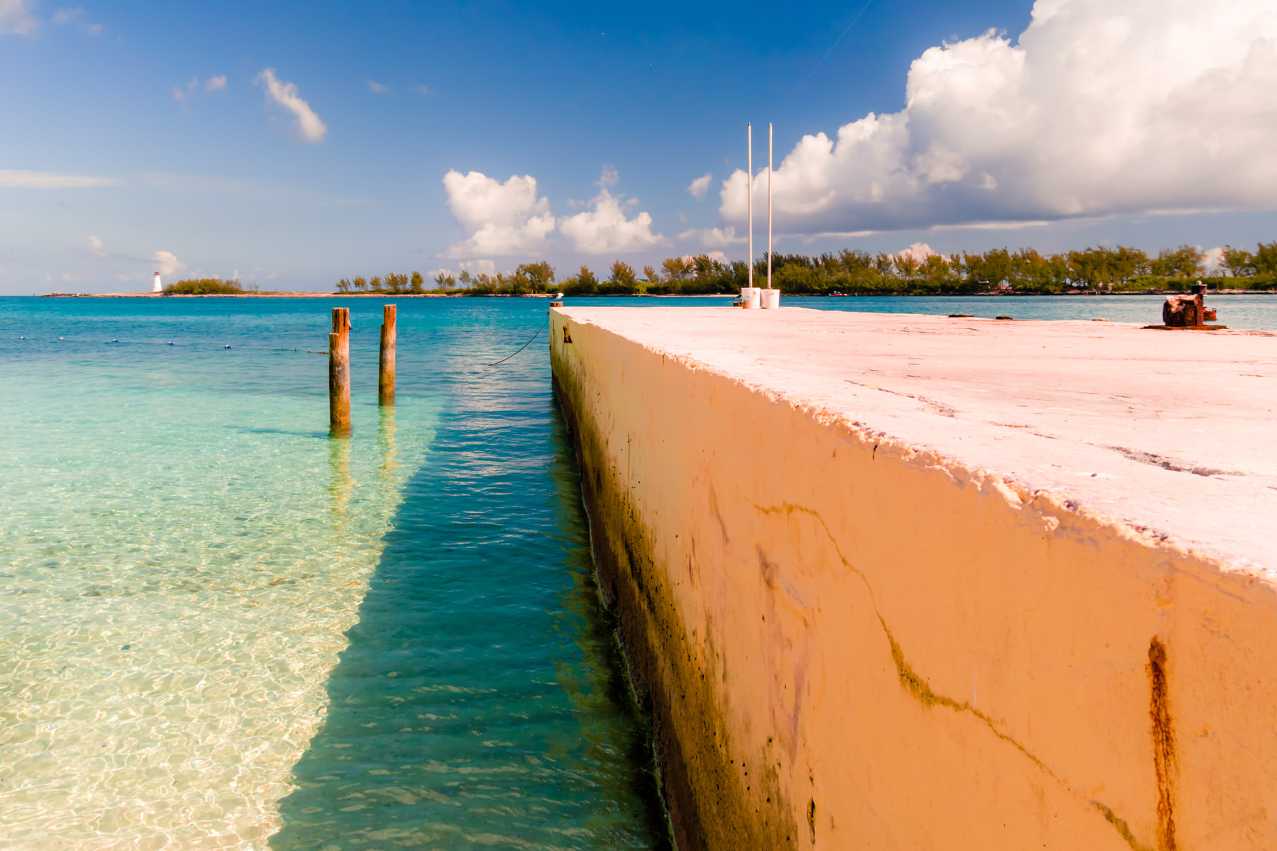 A barrier extends from the beach into the harbour at Nassau, Bahamas.