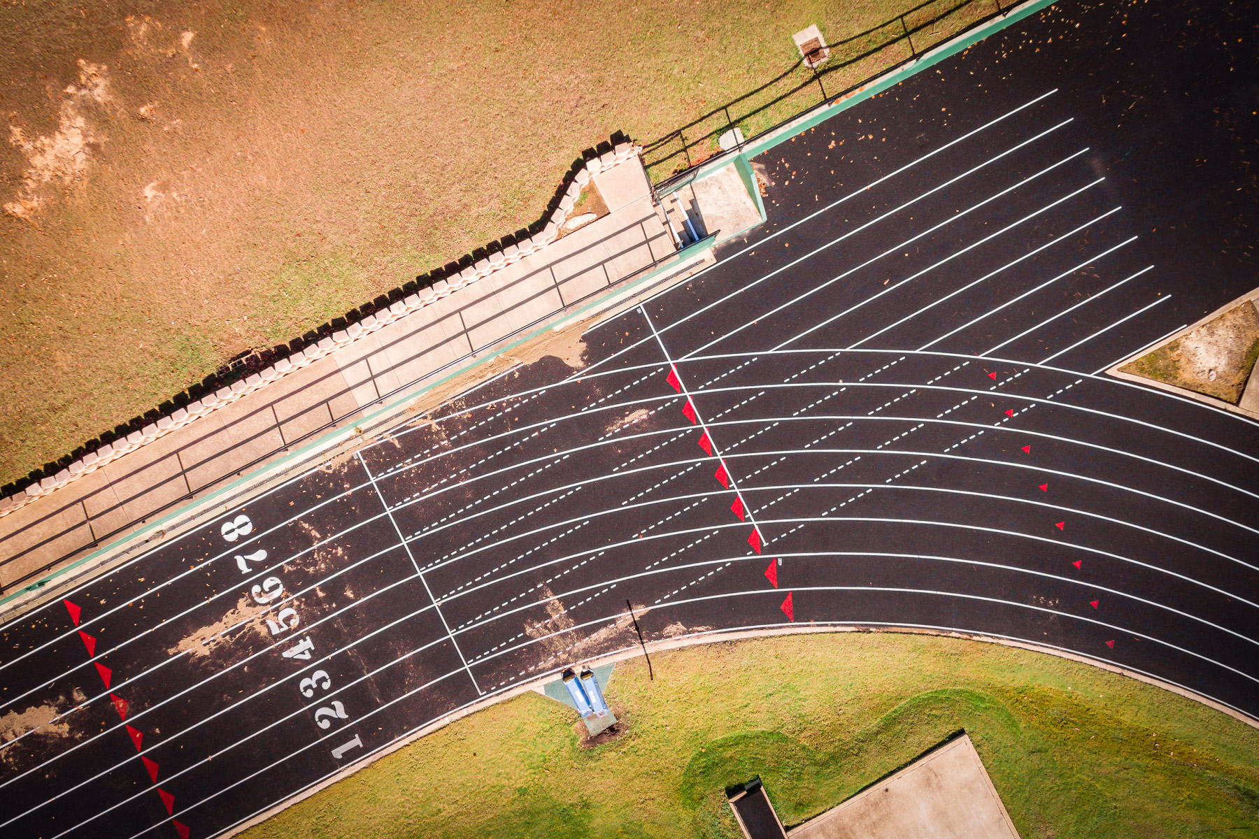 An abstract aerial view of the starting line of a high school stadium's track in Tyler, Texas.