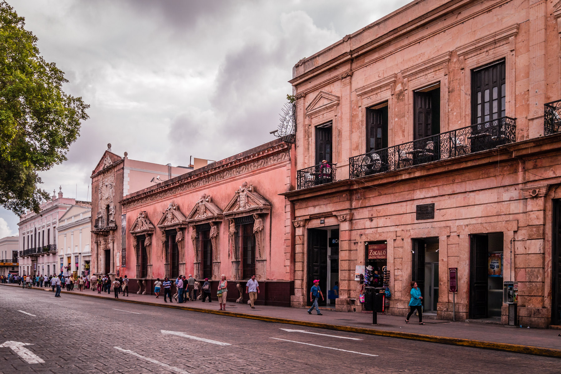 Pedestrians walk among the old buildings along Calle 63 in Mérida, Mexico.