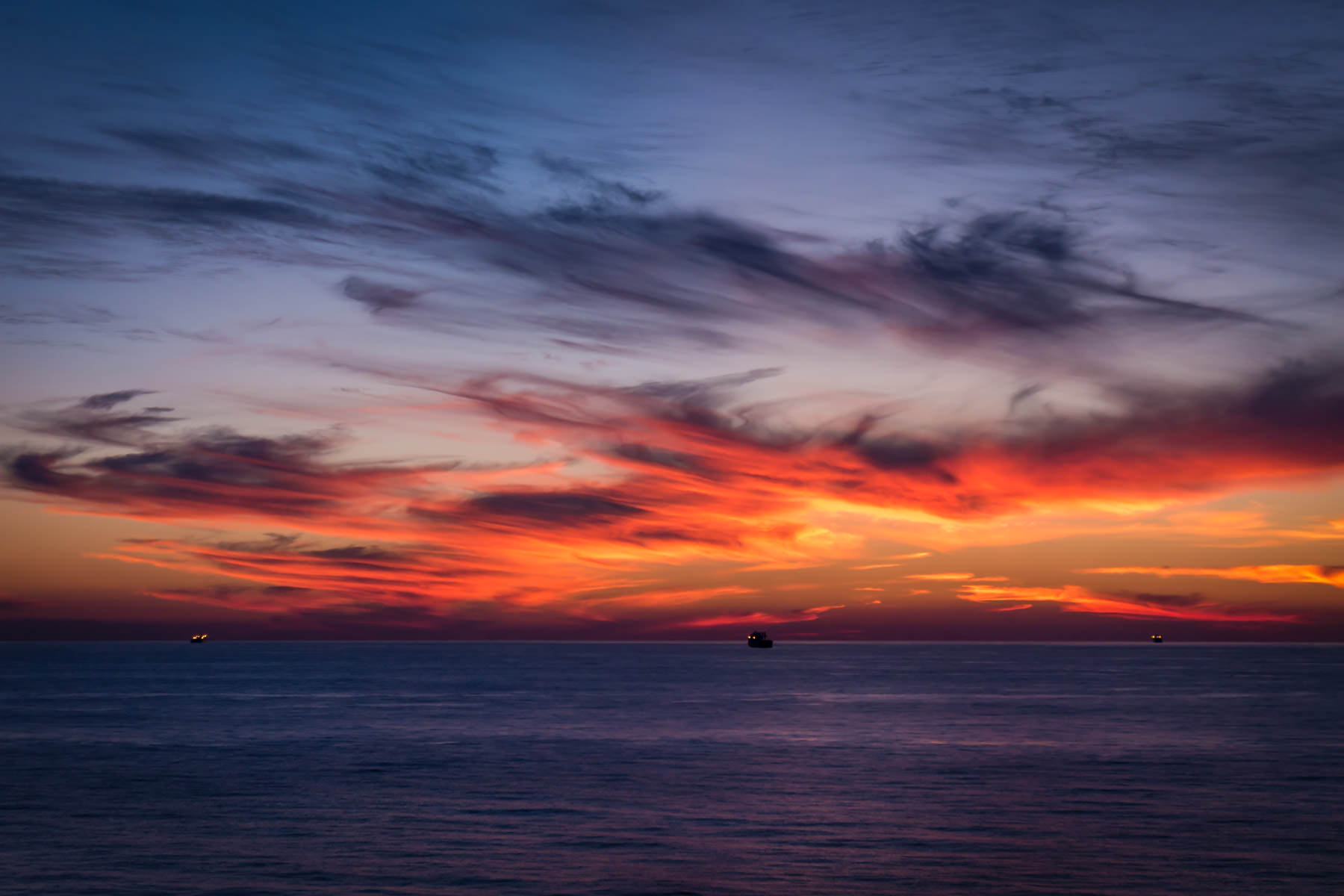 The sun rises on the Gulf of Mexico, just off the coast of Galveston, Texas.