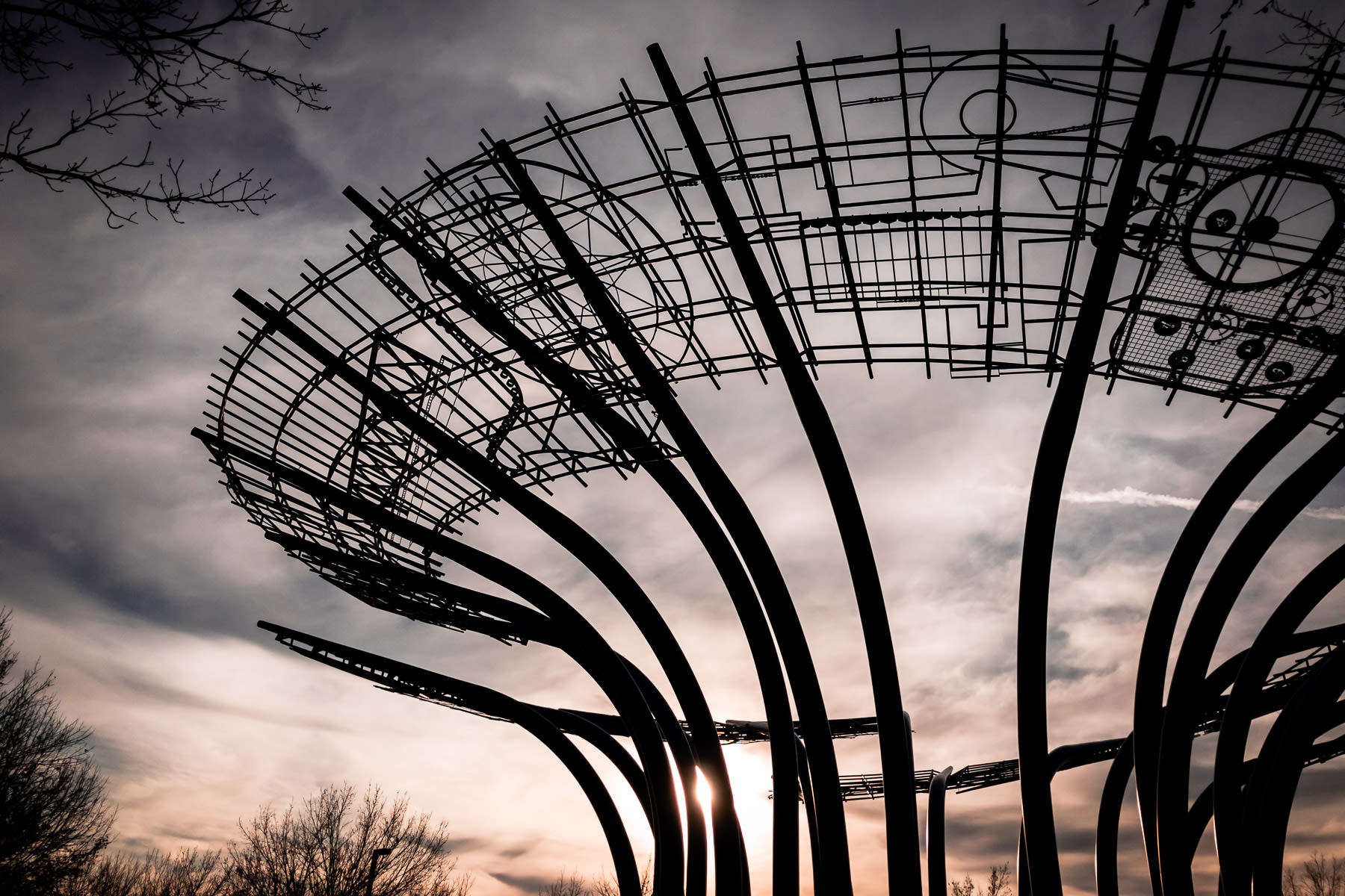 The sun sets on the 45-foot-tall, 140-foot-wide Blueprints sculpture at Addison Circle in Addison, Texas.