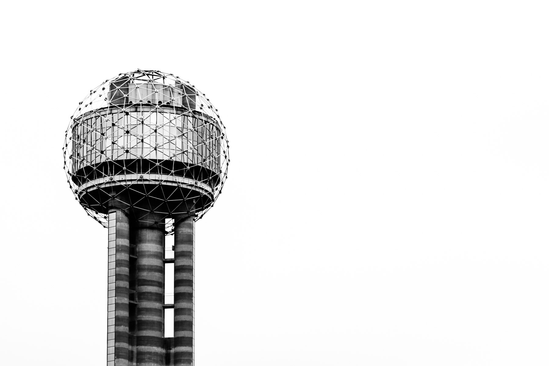 Dallas' Reunion Tower rises into the overcast sky over North Texas.