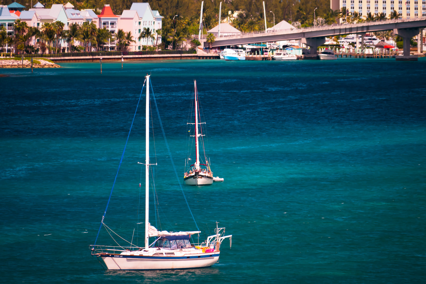 Two sailboats float in the harbour at Nassau, Bahamas.
