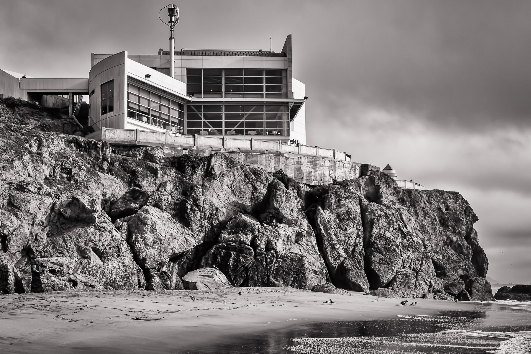 The modern wing of the historic Cliff House restaurant overlooks the beach at Lands End, San Francisco.