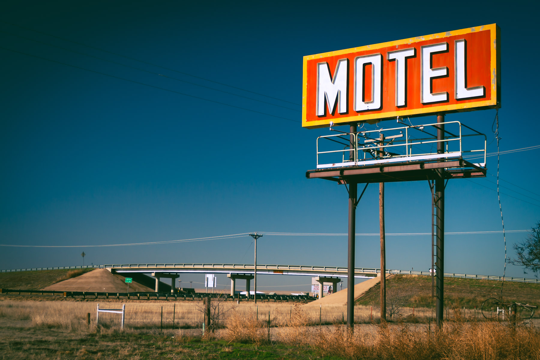 A billboard advertising at hotel in Adrian, Texas, stands watch over nearby Interstate 40.