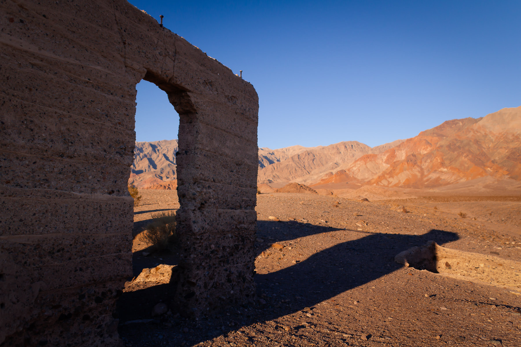 The Ashford Mill ruins cast long shadows in the dry desert at California's Death Valley National Park.