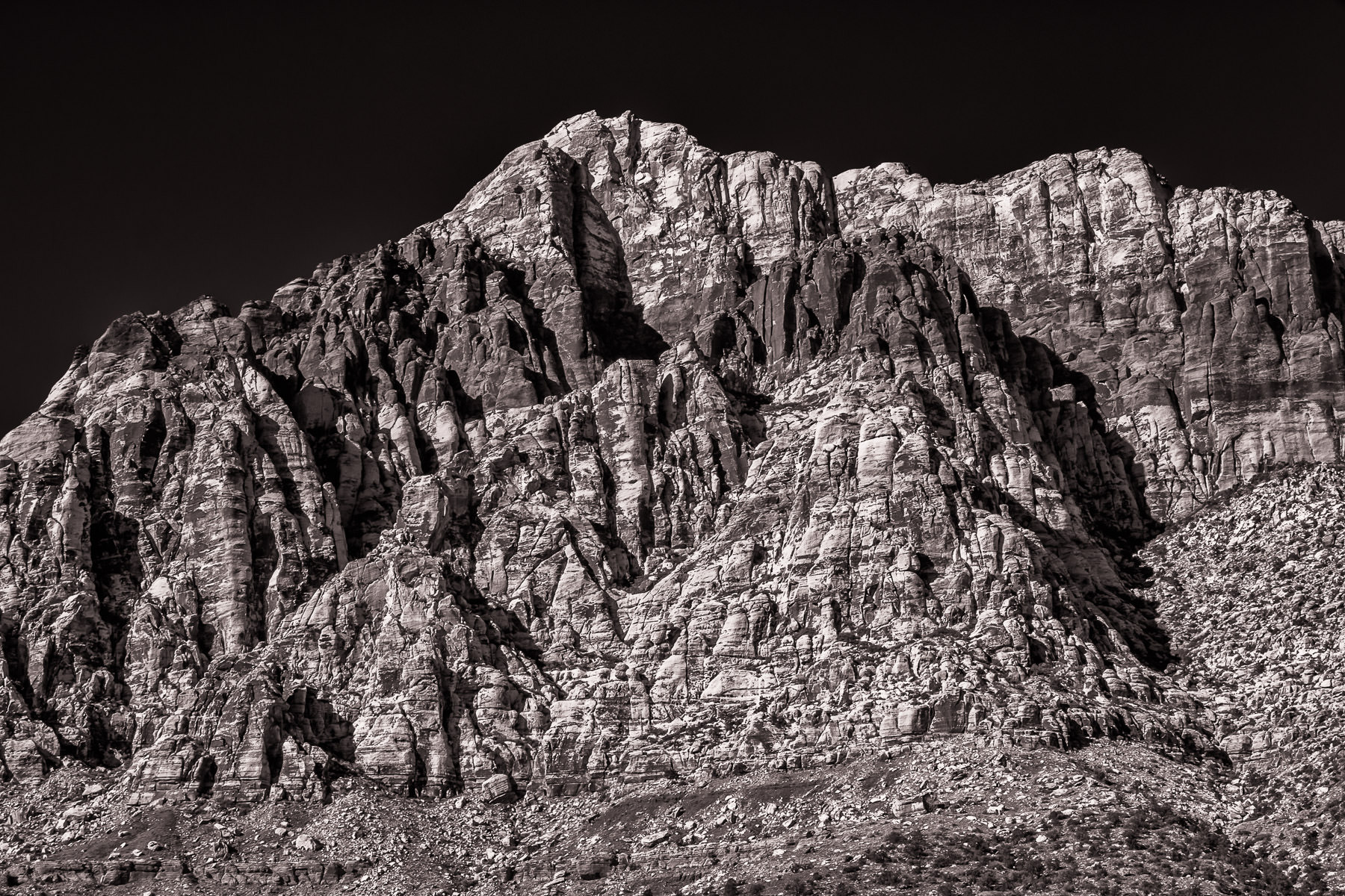A dry, rocky ridge bakes in the Nevada sun at Red Rock Canyon.