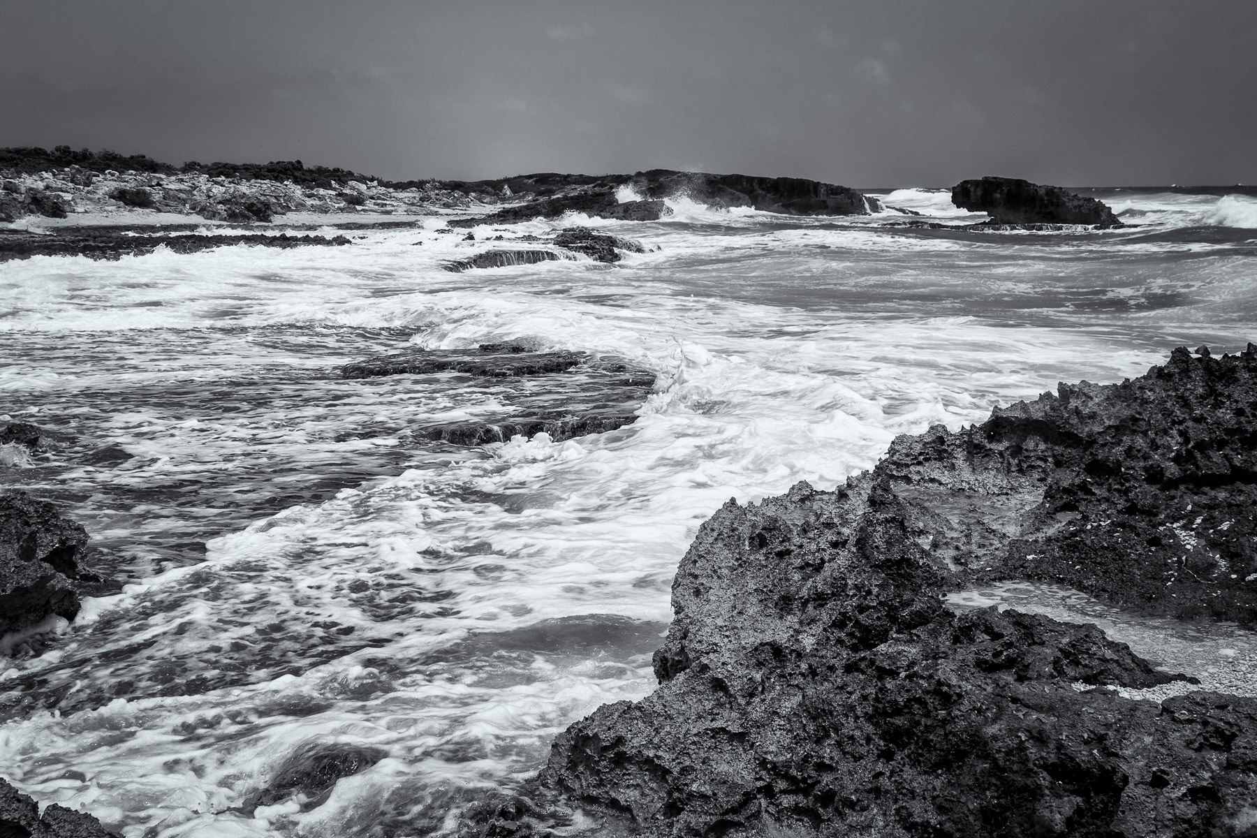 The surf crashes onto the rocks at El Mirador on the coast of Cozumel, Mexico.