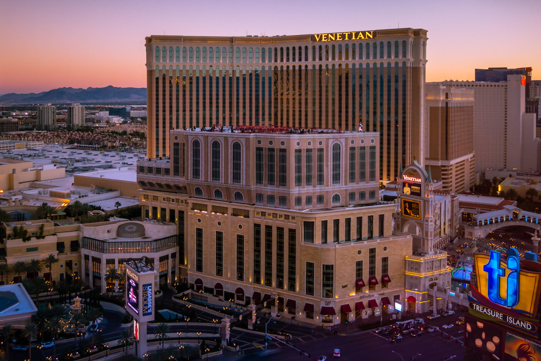 The sun sets on the Venetian Hotel & Casino and the Las Vegas Valley.