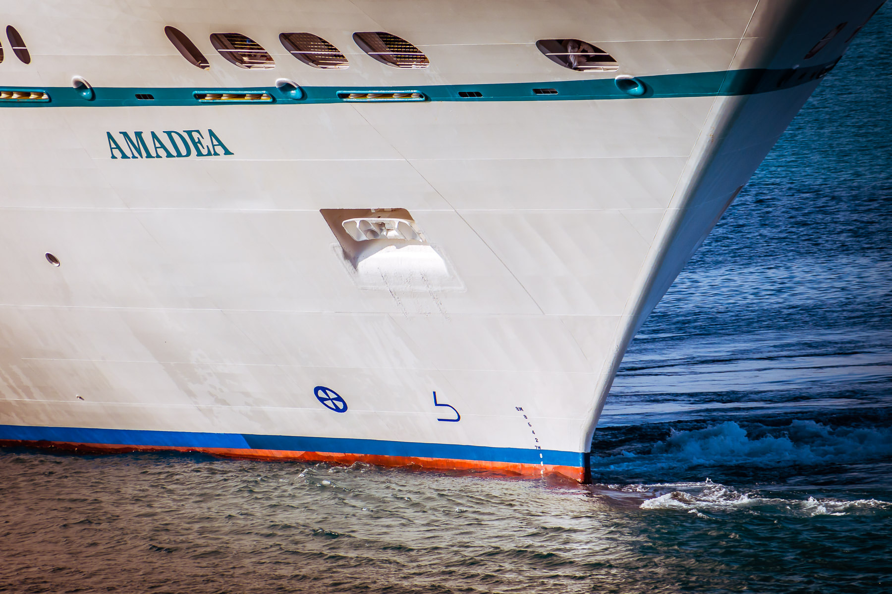 The bow of the cruise ship Amadea cuts through the water as she begins to depart Freeport, Bahamas.