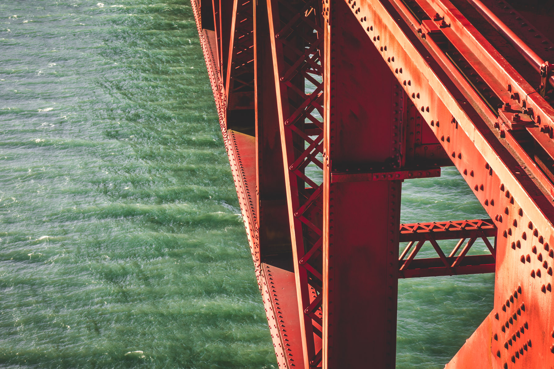 The support structure of the Golden Gate Bridge's roadway floats above the entrance to San Francisco Bay.