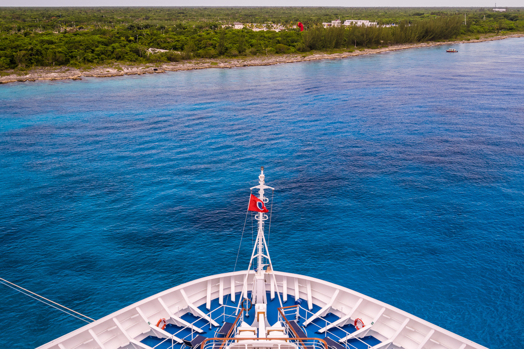 The bow of the cruise ship Carnival Breeze floats in the blue waters just off the coast of Cozumel, Mexico.
