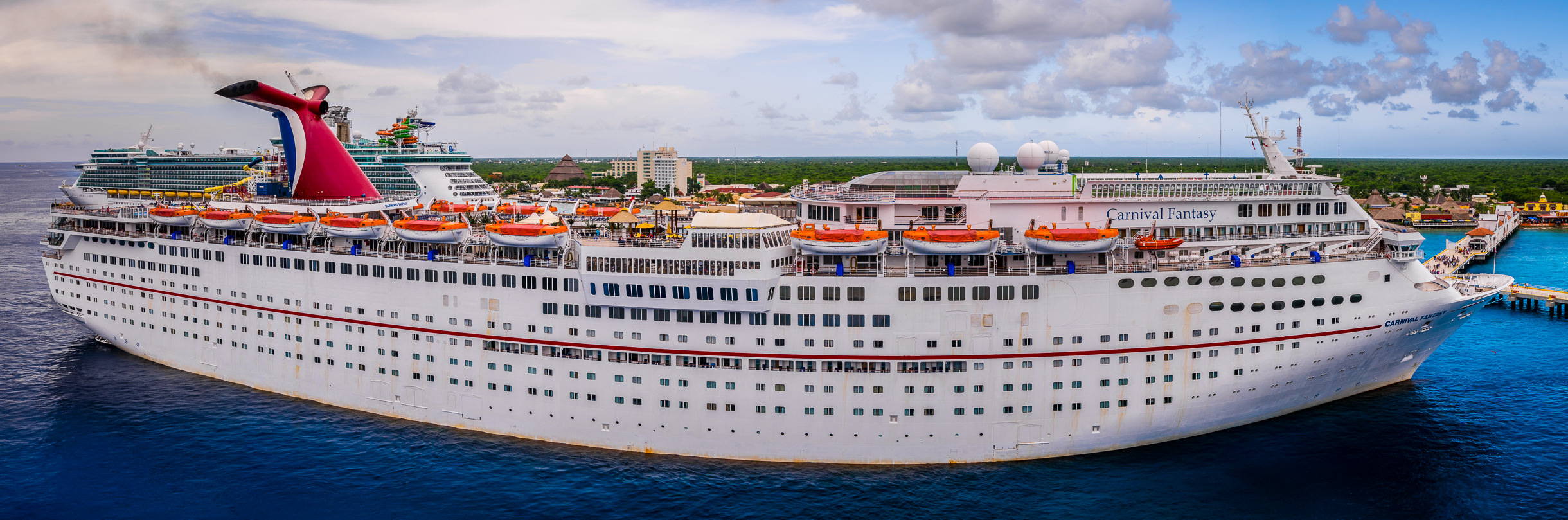 A panoramic view of the cruise ship Carnival Fantasy, docked in Cozumel, Mexico.
