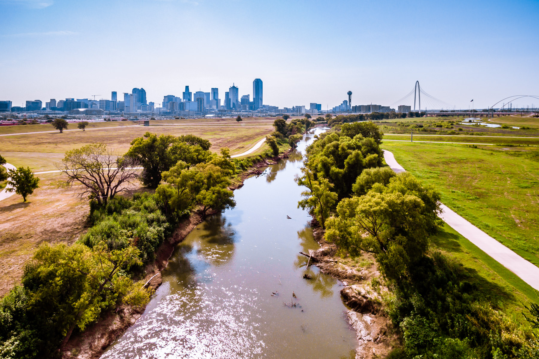 The Trinity River flows towards Downtown Dallas.
