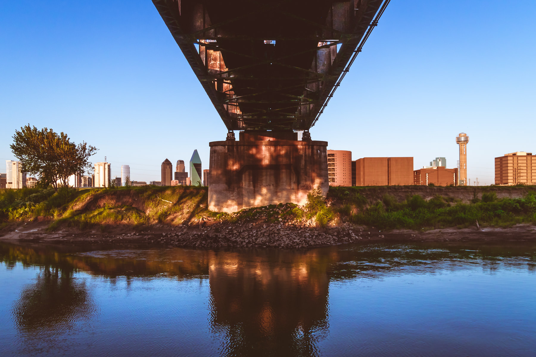 A railroad bridge crosses the Trinity River just west of Downtown Dallas.