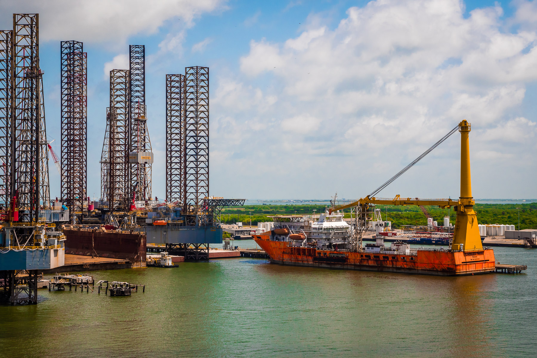 The offshore supply ship Caballo Maya, docked adjacent to jack-up oil platforms at Pelican Island, Galveston, Texas.